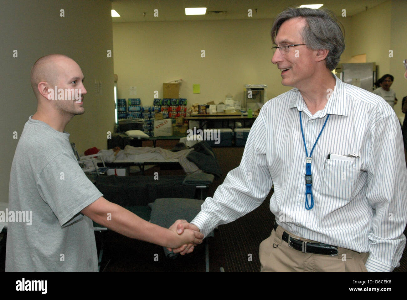 Lab director greets employee who was evacuated - Stock Image