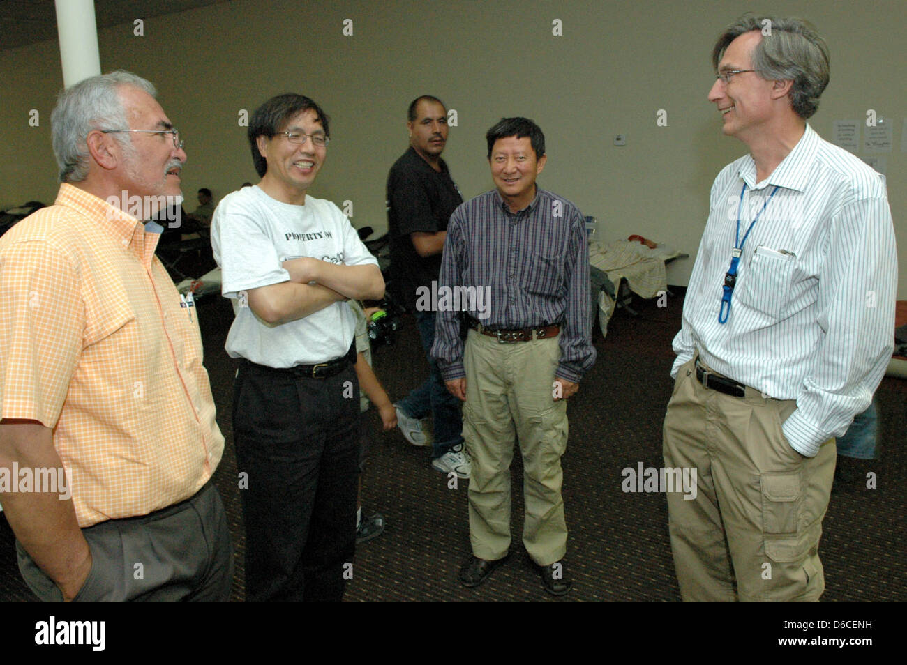Senior managers McMillan & Marquez visit Laboratory employees evacuated from their homes - Stock Image