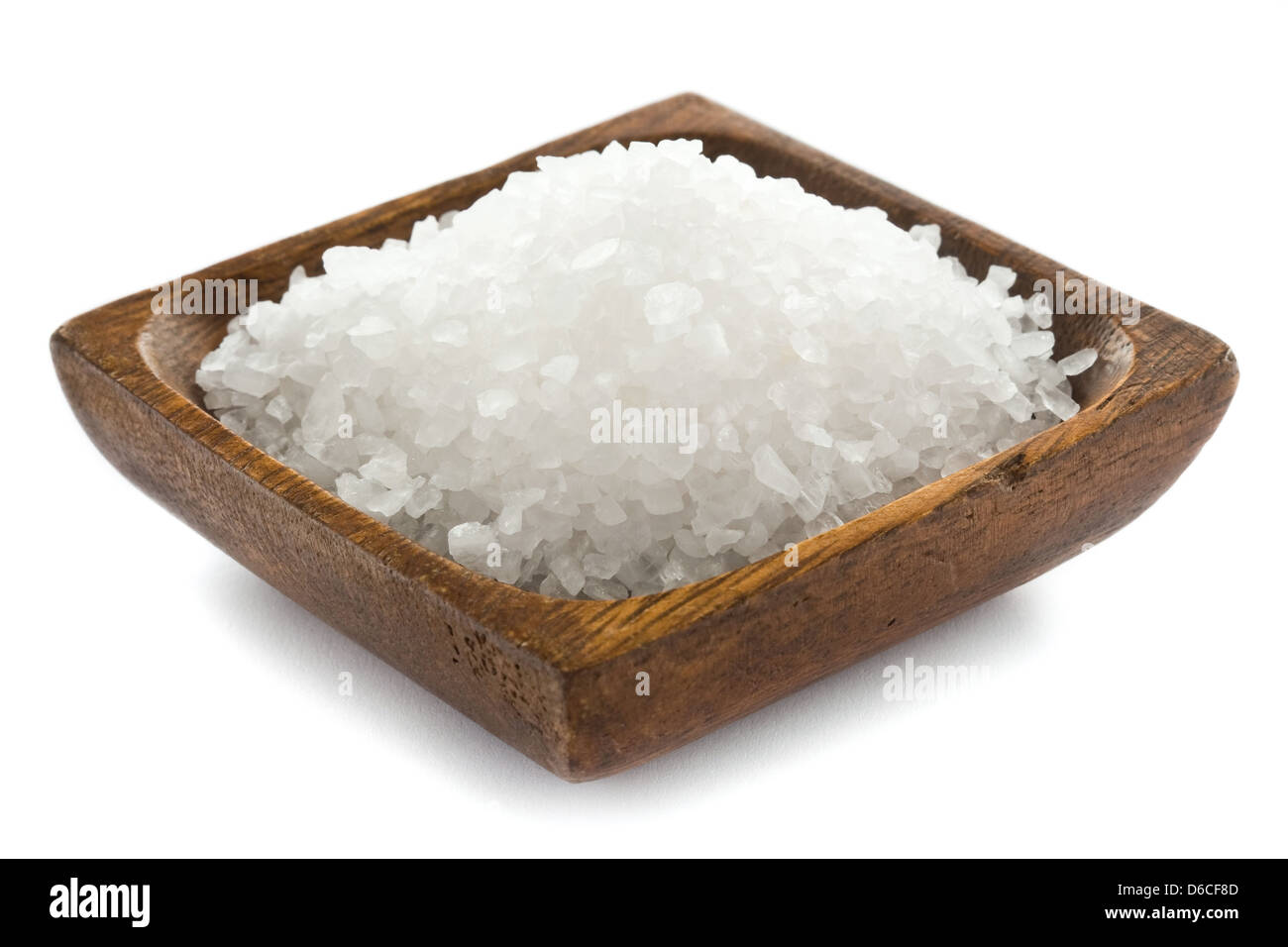Healthy sea salt in wooden bowl closeup - Stock Image