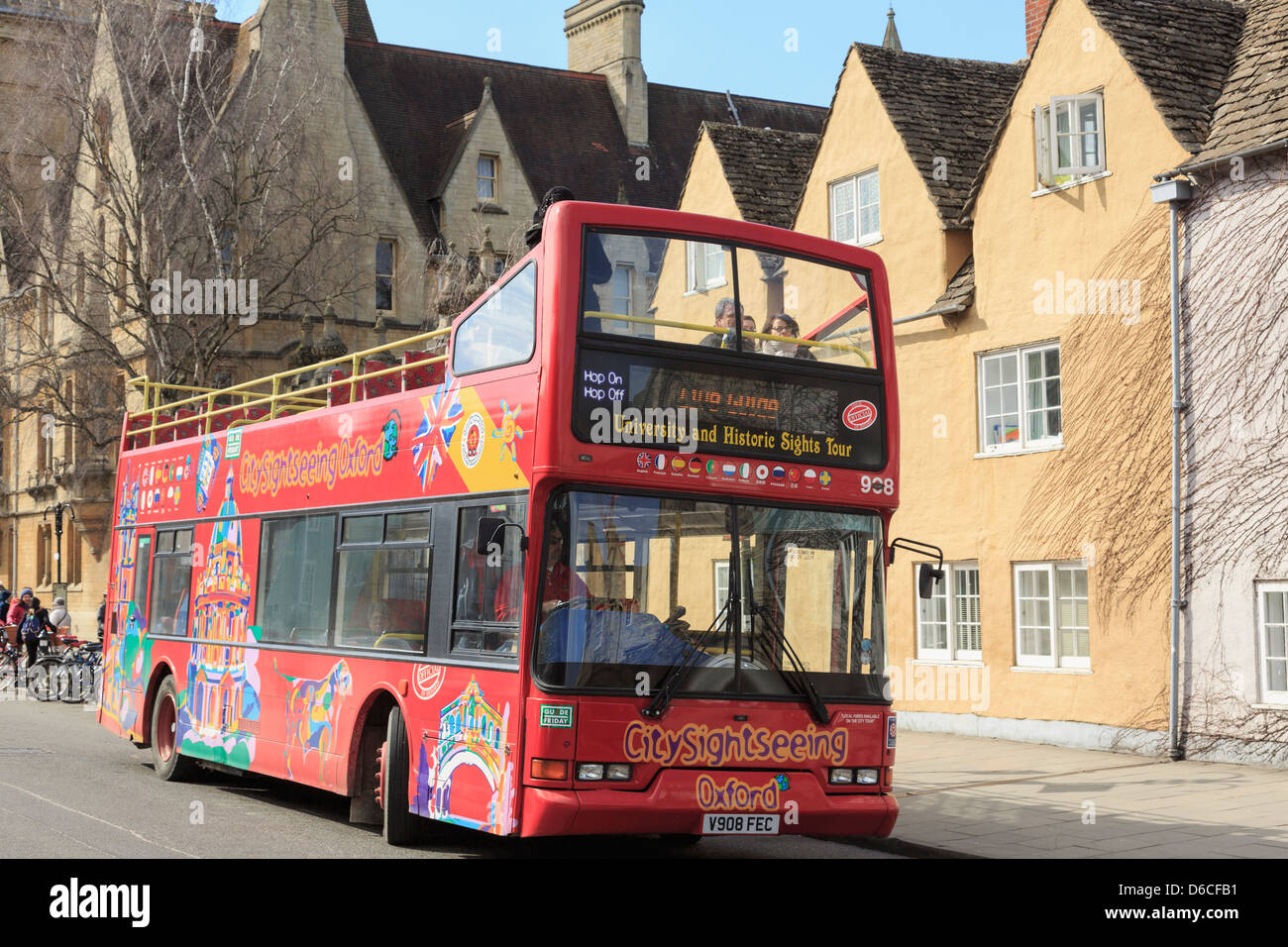 Red Hop On Hop Off tourists sightseeing bus on university and historic sights tour of the city. Oxford, Oxfordshire, - Stock Image