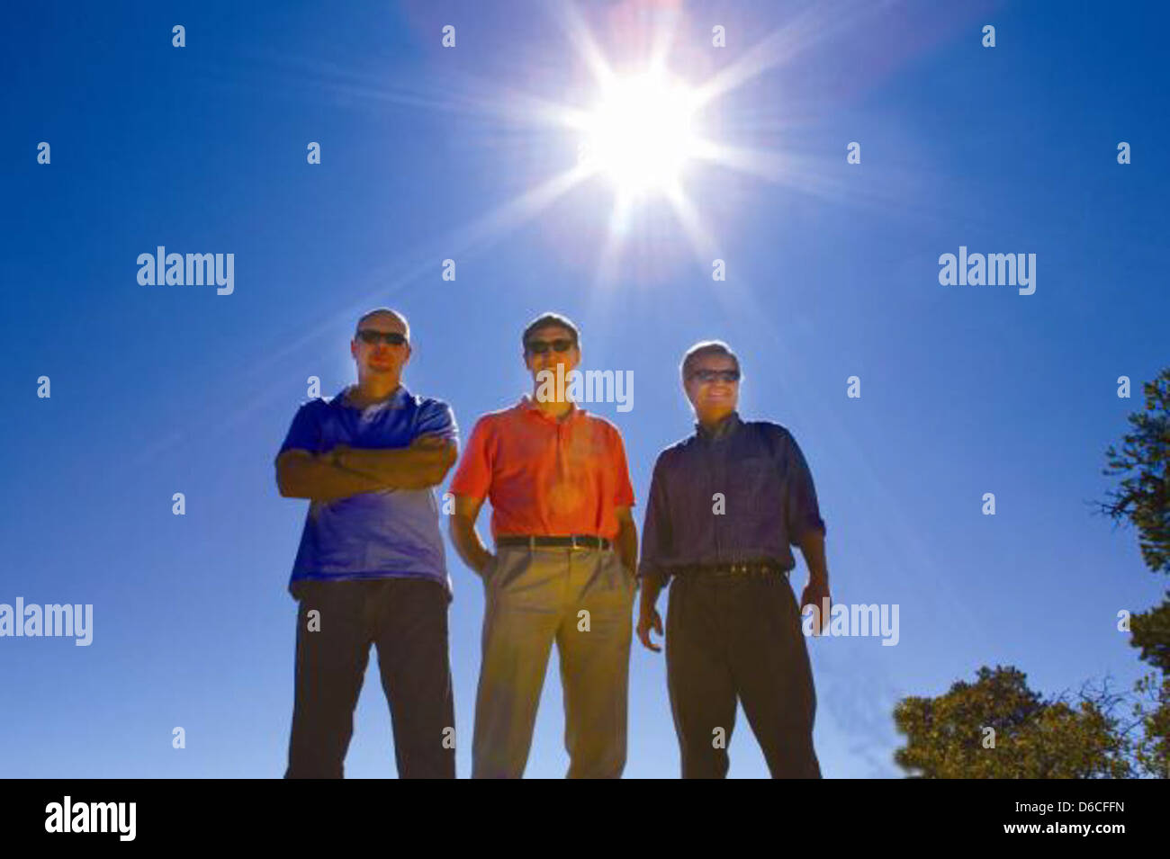 Left to right, Los Alamos physicists Richard Van de Water, Bill Louis, and Geoff Mills - Stock Image