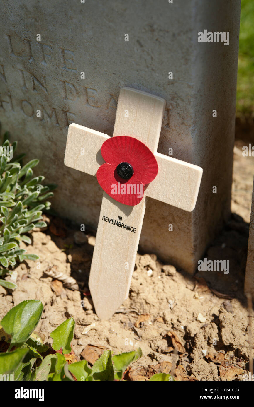 Wooden remembrance cross and poppy at the Devonshire cemetery in Mametz, northern France. Stock Photo