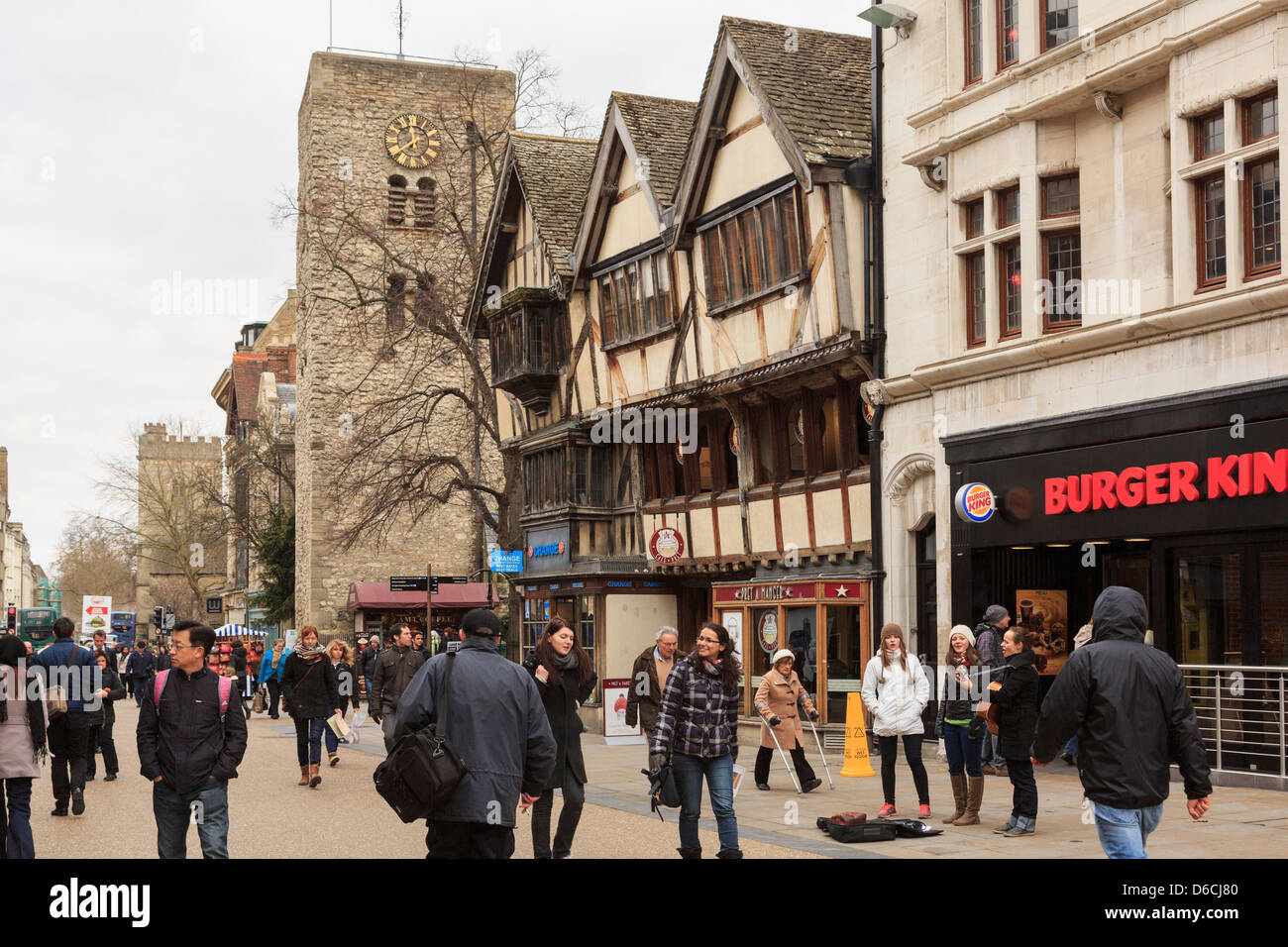 Shoppers in old historic city centre on pedestrianised Cornmarket Street in Oxford, Oxfordshire, England, UK, Britain - Stock Image