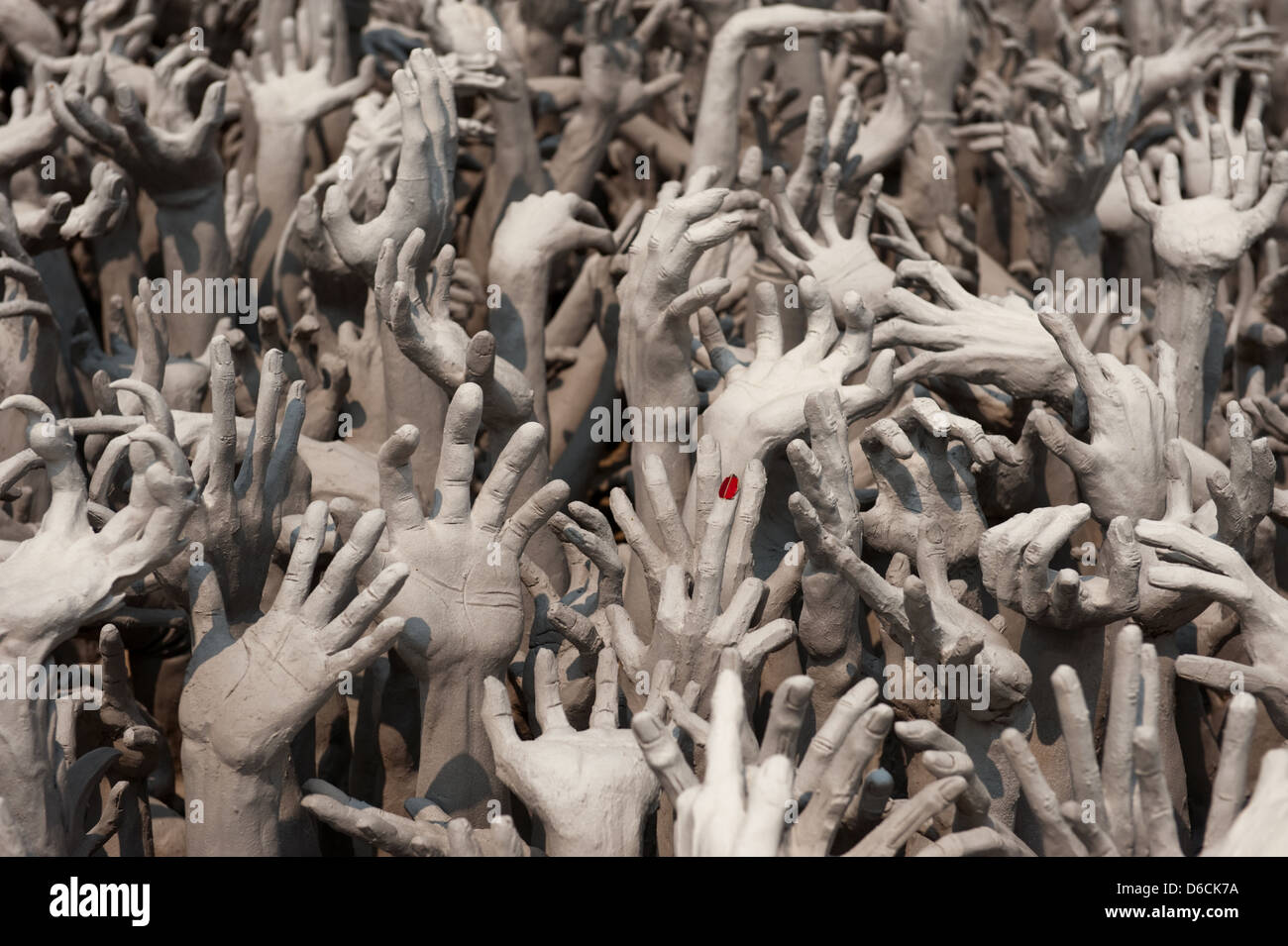 Chiang Rai, Thailand, outstretched hands symbolize the hell - Stock Image