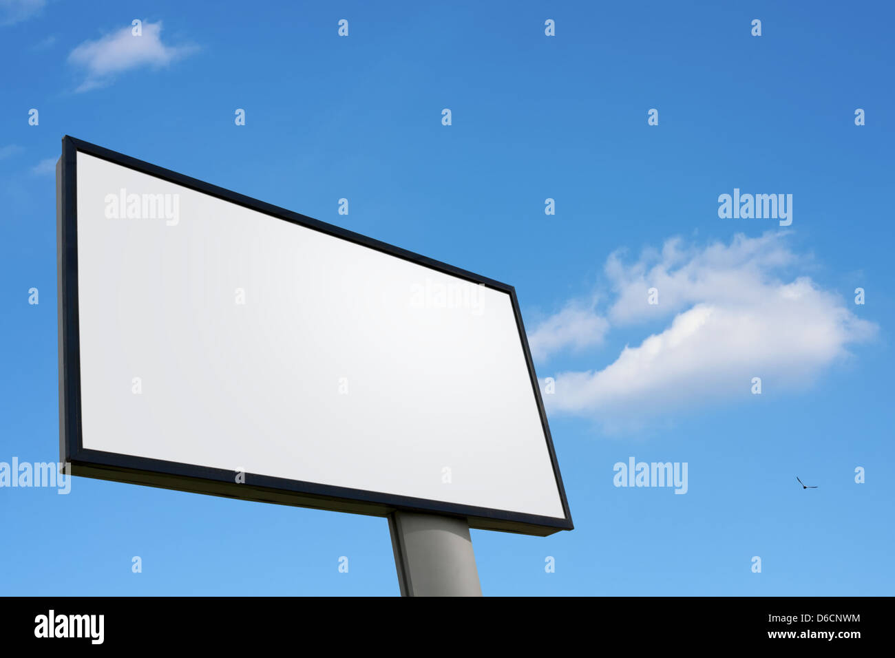 Big white advertising wall on blue sky - Stock Image