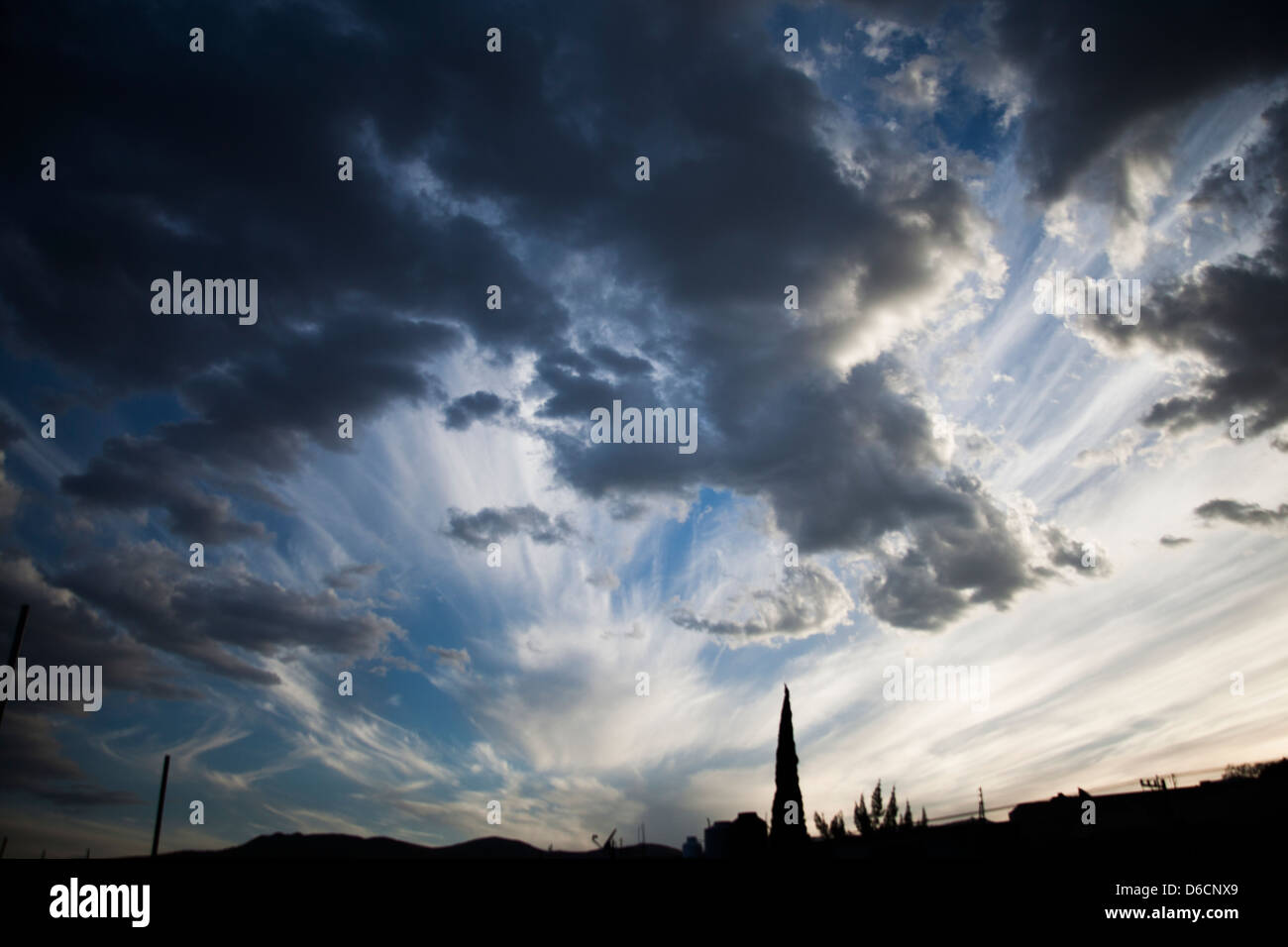 A striking sunset graces the Oaxacan sky in the winter months. - Stock Image