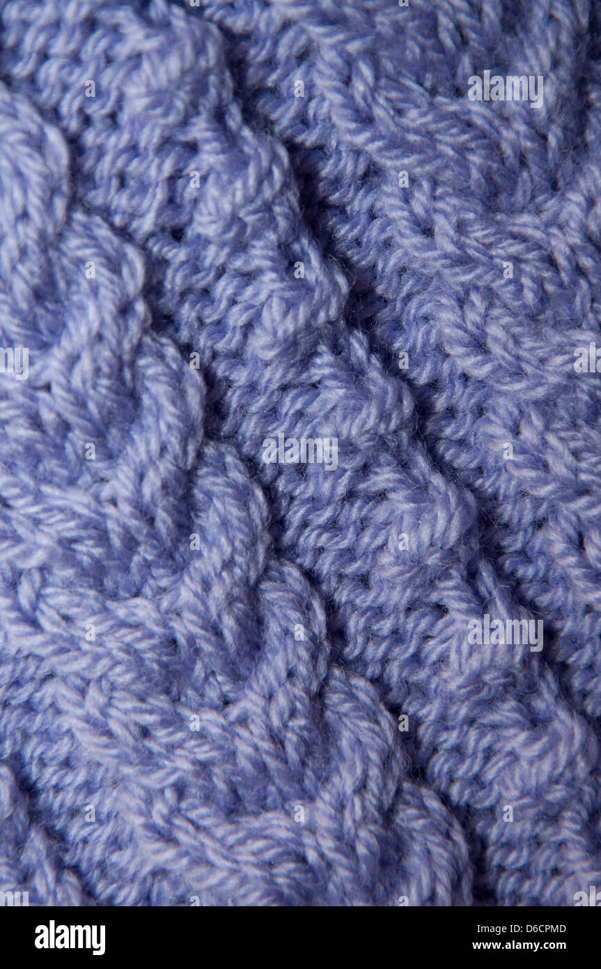 wool knitted garment in close up, texture, detail, abstract, side lit, handicrafts, past times, hobbies - Stock Image