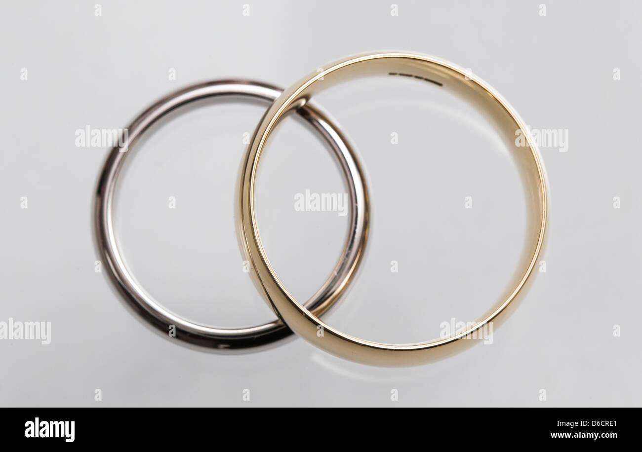 Two Weddings Rings Intertwined Stock Photo 55600889 Alamy