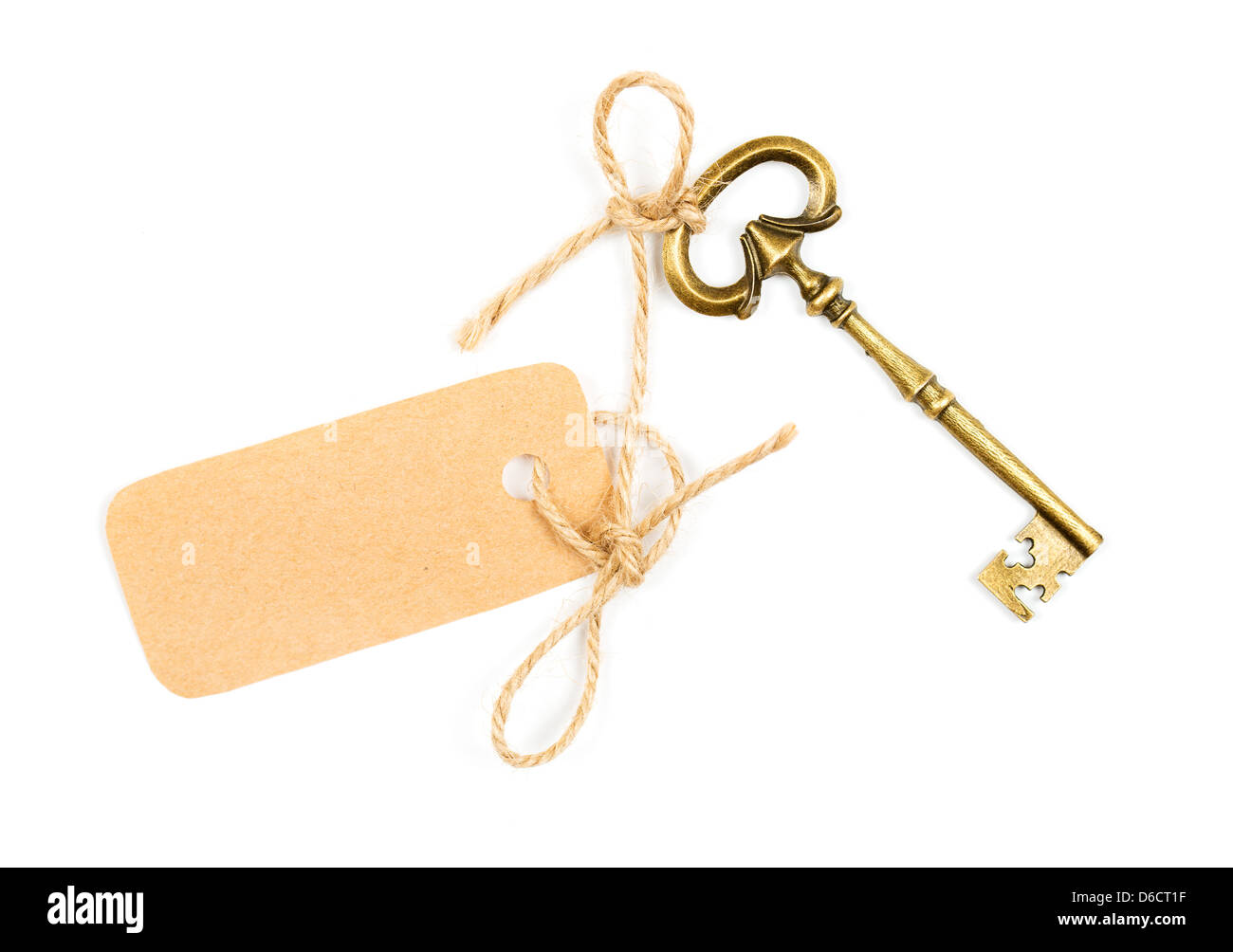 Vintage key with a tag for the text on white - Stock Image