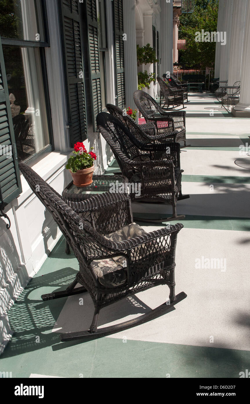 Photograph of black wicker rocking chairs on large spacious Southern veranda with pots of Geraniums & Veranda Rocking Chairs Stock Photos u0026 Veranda Rocking Chairs Stock ...