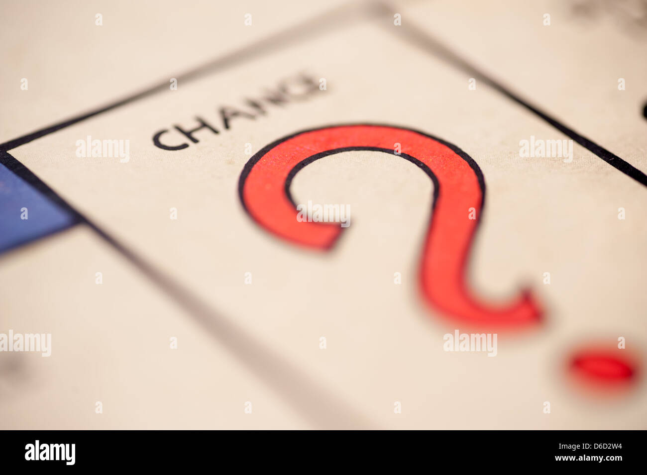 A question mark picture of the board game Monopoly landing on chance. - Stock Image