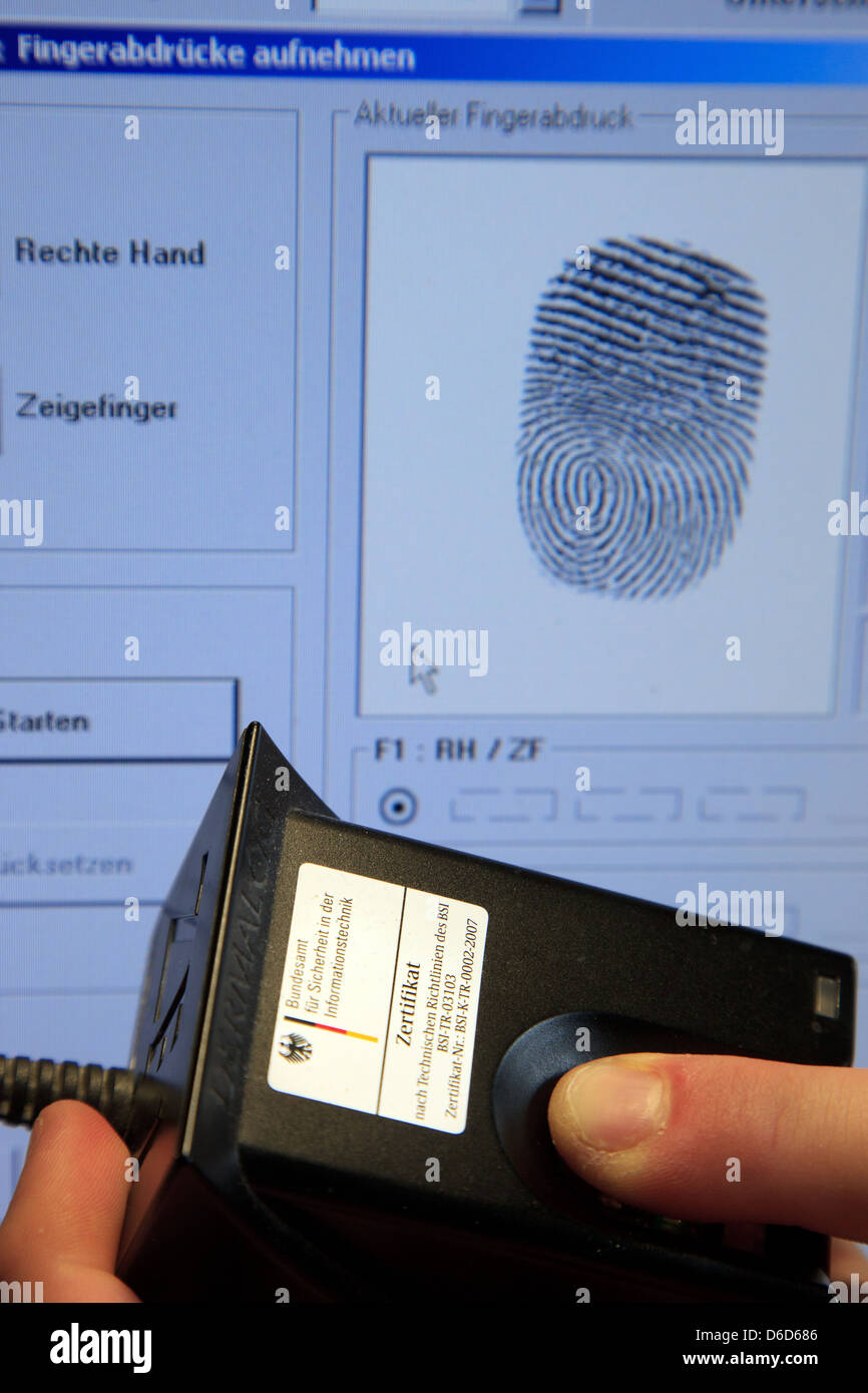 Berlin, Germany, show fingerprint is scanned for the passport - Stock Image