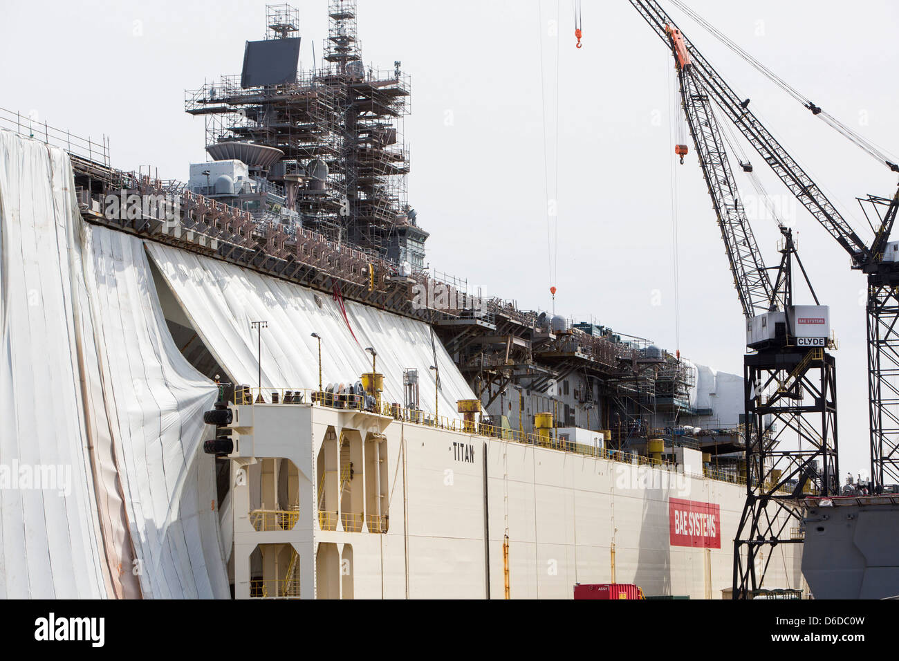 United States Navy ships under repair in the BAE systems shipyard in Norfolk, Virginia - Stock Image