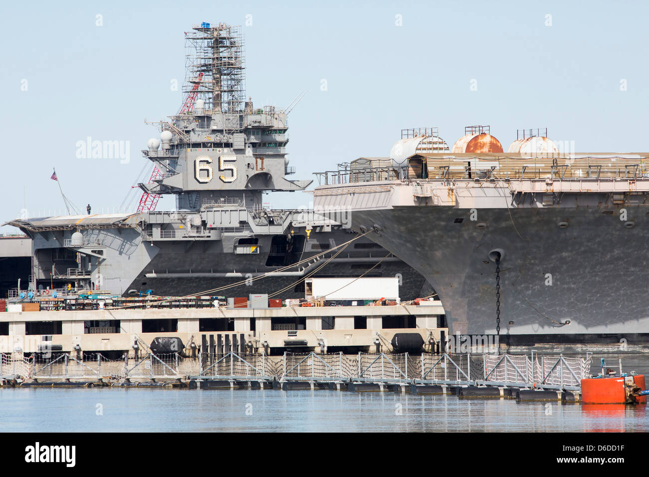 The aircraft carriers USS Abraham Lincoln (CVN-72) and USS Enterprise (CVN-65) at Naval Station Norfolk. - Stock Image