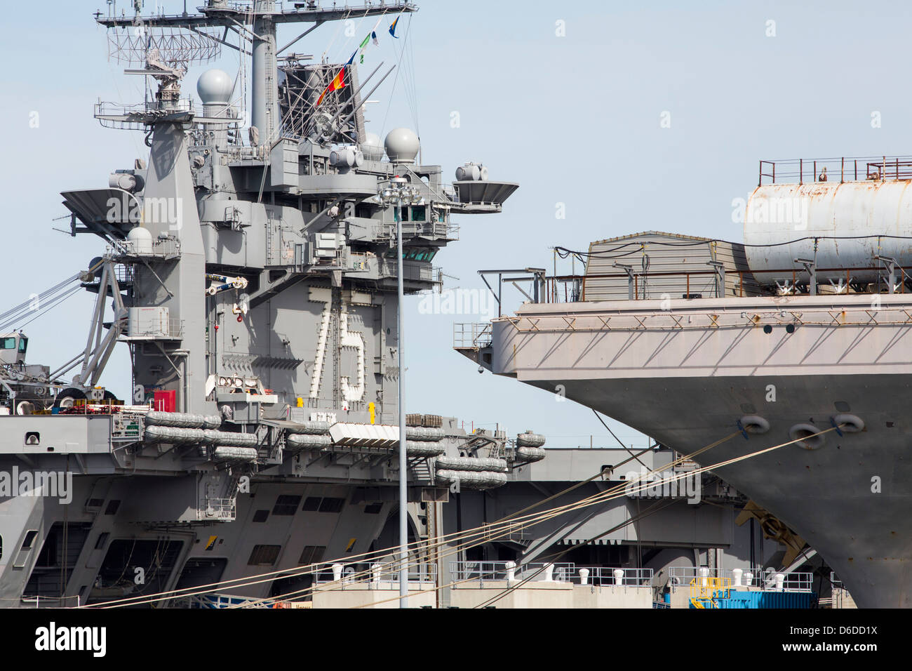 The aircraft carriers USS Harry S. Truman (CVN 75) and USS Abraham Lincoln (CVN-72) at Naval Station Norfolk. - Stock Image