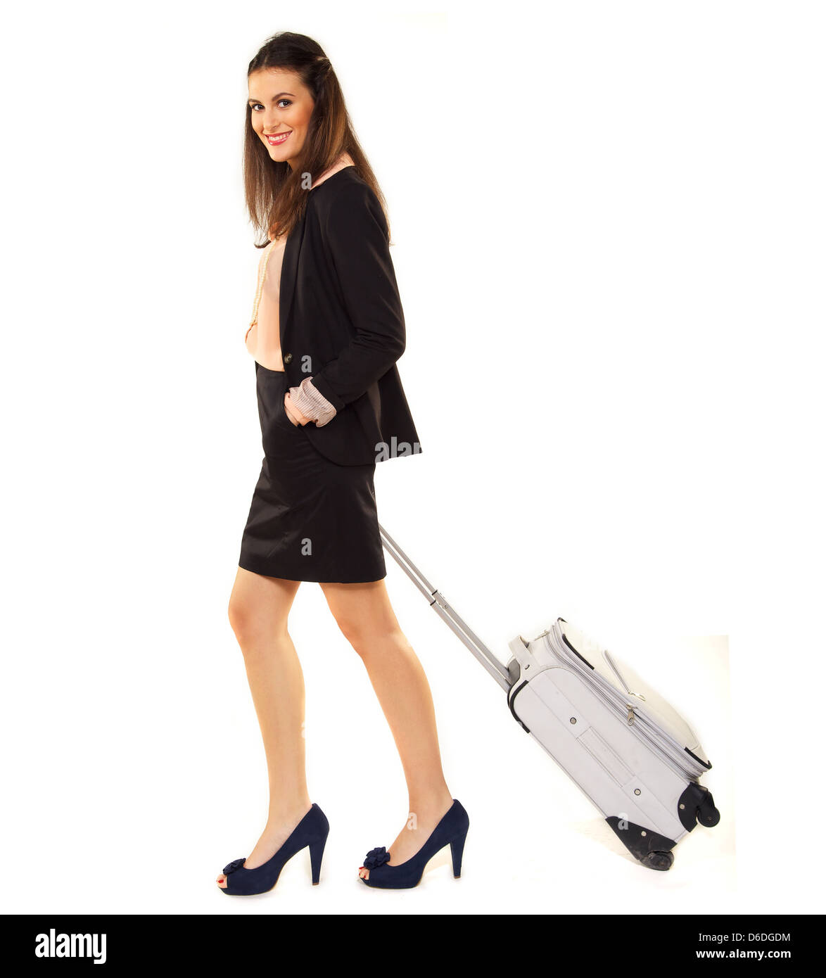 Young professional with her luggage isolated on white - Stock Image