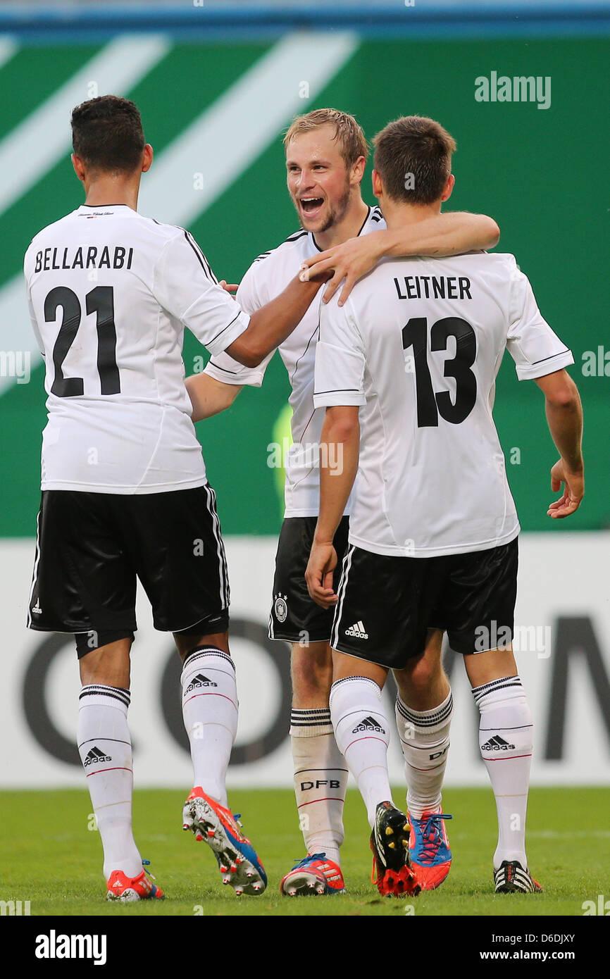 Germany's Karim Bellarabi (L-R), goal scorer Maximilian Beister and Moritz Leitner celebrate the 1-0 goal during - Stock Image