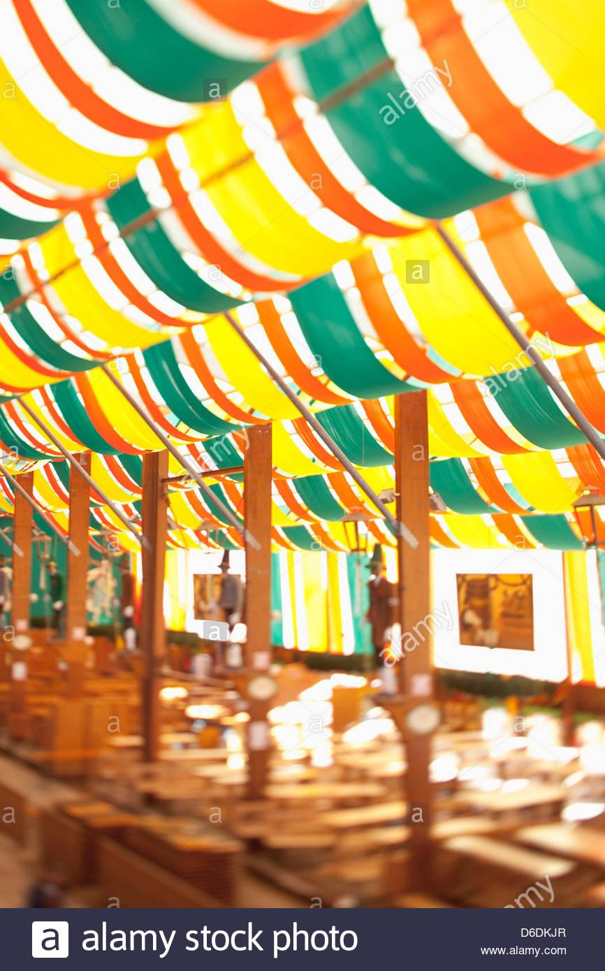 Beer tent Oktoberfest Munich defocused empty - Stock Image
