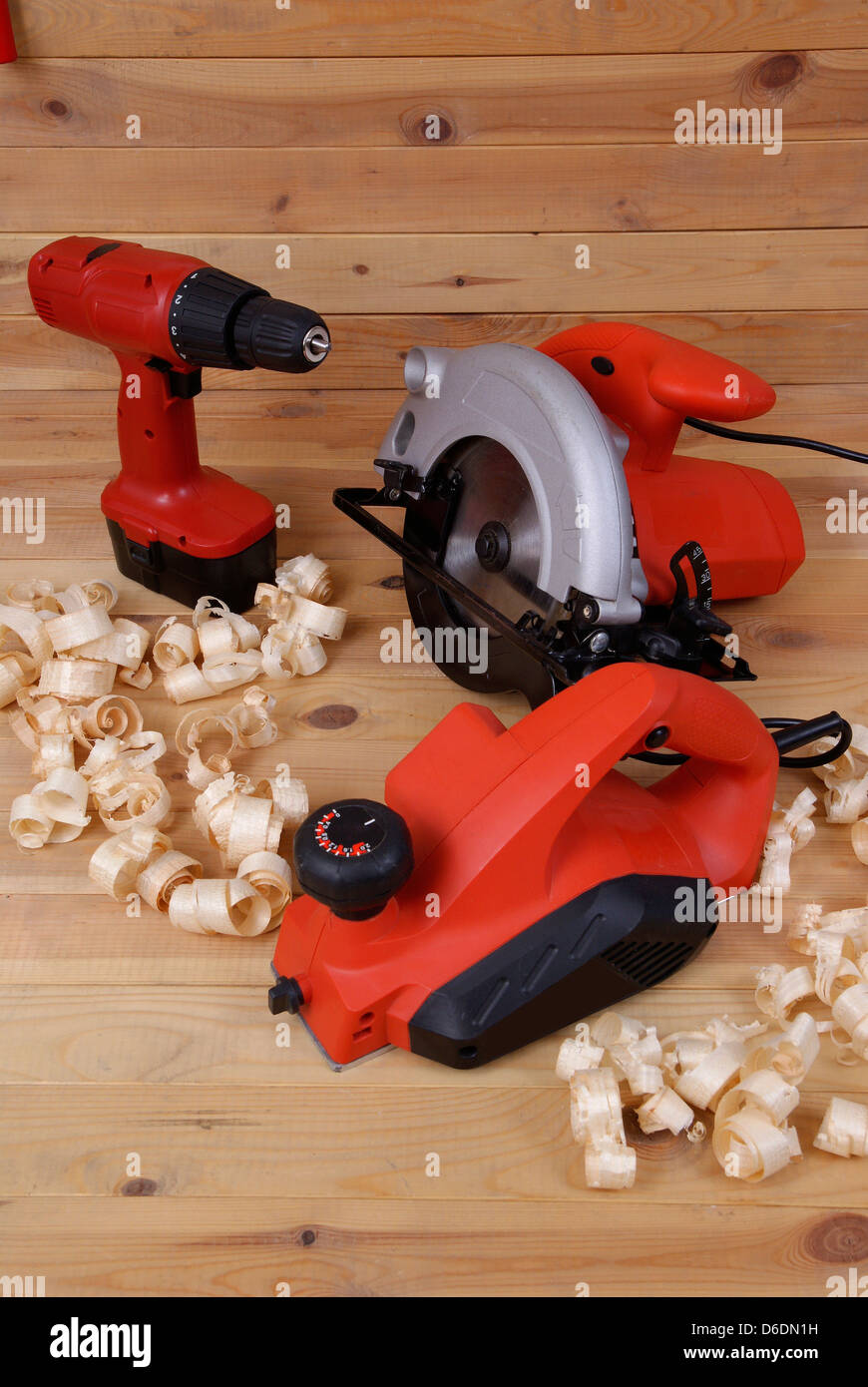 three types electric instruments and shaving woods on table - Stock Image