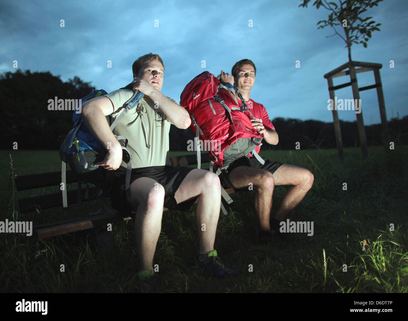 Extreme hicker Dennis Bettin(L)and friend Marco Storsberg put their backpacks on in Wermelskirchen,Germany, - Stock Image