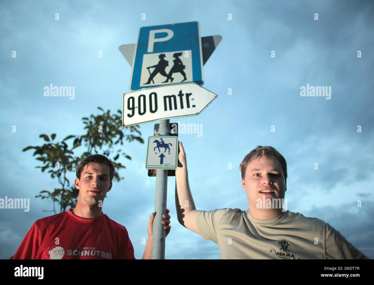 Extreme hicker Dennis Bettin(L)and friend Marco Storsberg stand in a parking lot for hikers in Wermelskirchen,Germany, - Stock Image