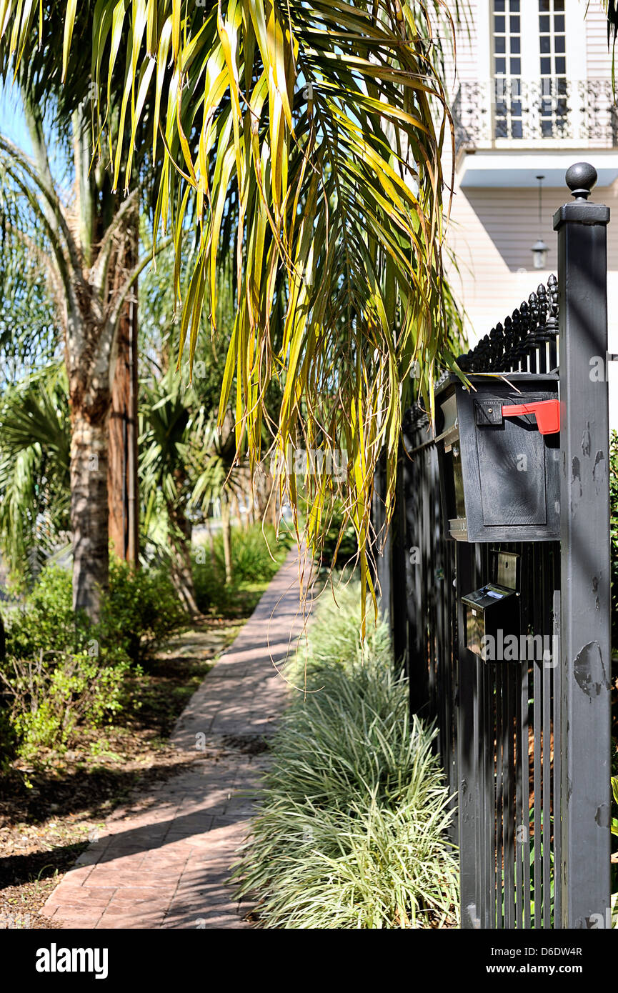 New Orleans Style Mailboxes Part - 19: American mailbox attached to railings by the side of a house , New Orleans,  USA