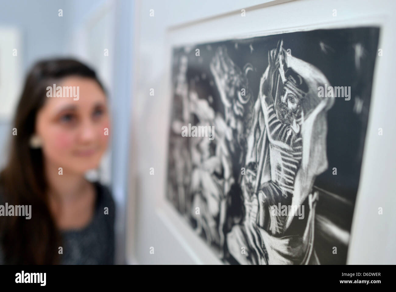 A young woman looks at the etching 'Blind Minotaur led by a Young Girl' by Picasso at the Kunstsammlungen - Stock Image