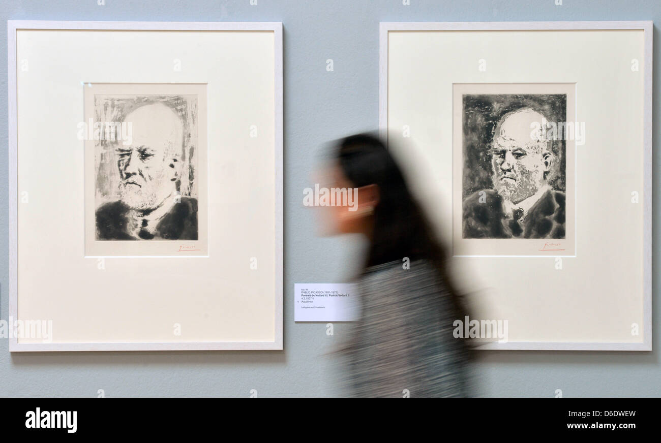 A young woman walks past the series 'Portrait de Vollard' by Picasso at the Kunstsammlungen Chemnitz in - Stock Image