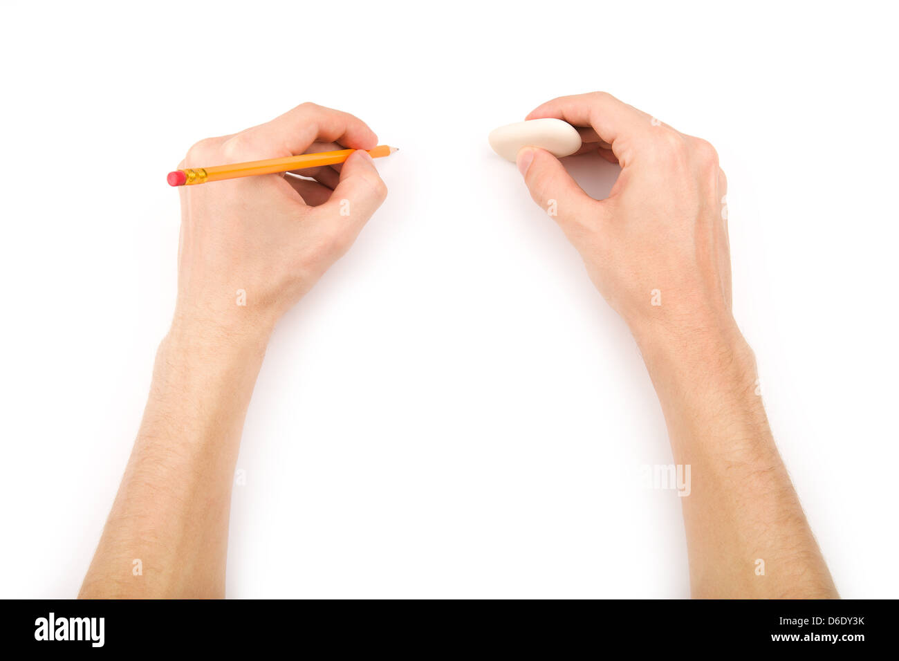 Left-hander with pencil and eraser - Stock Image