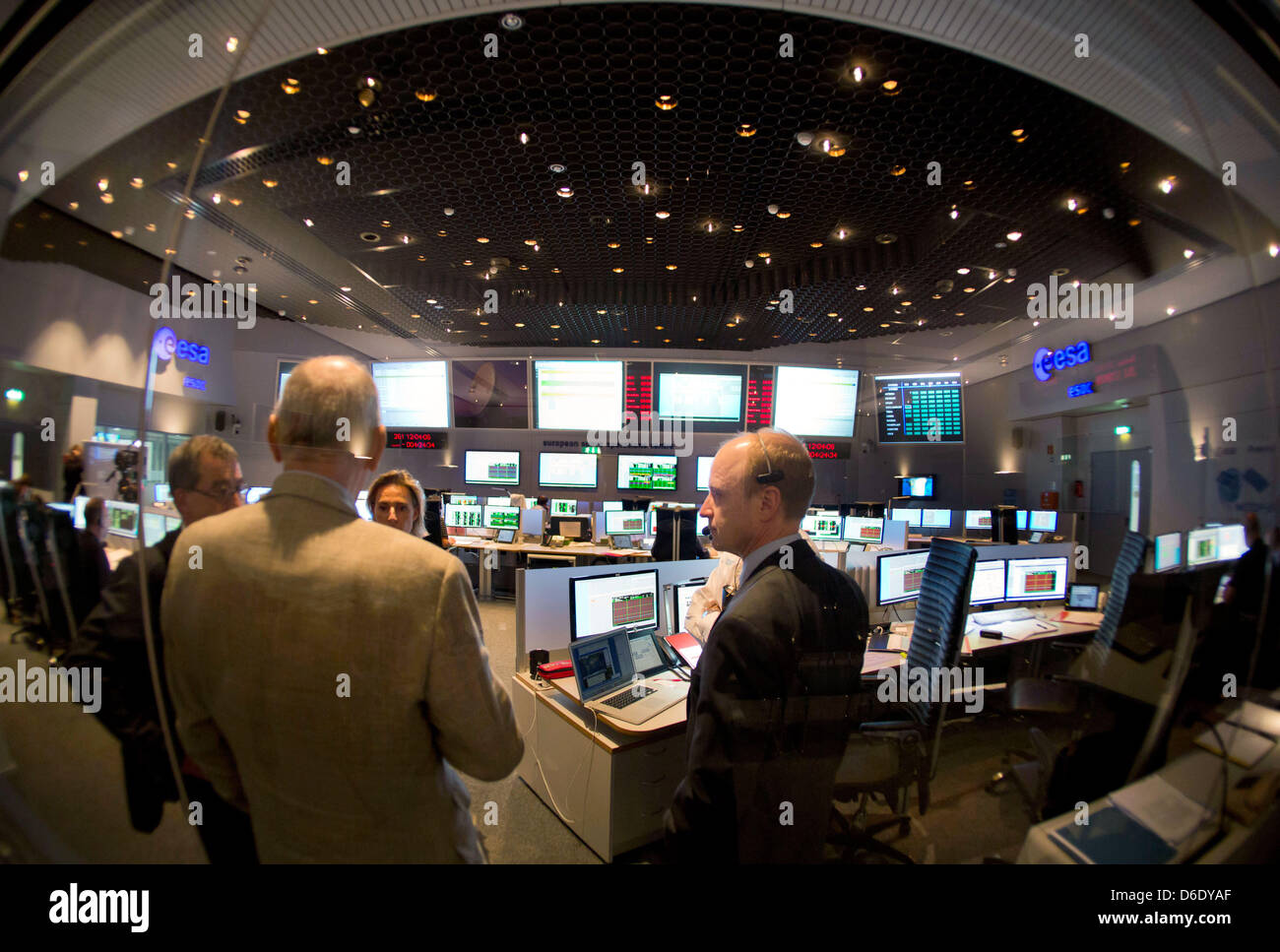 ESA Employees and Ground Segment Manager Andreas Rudolph (R) are at work in a control room of the European - Stock Image