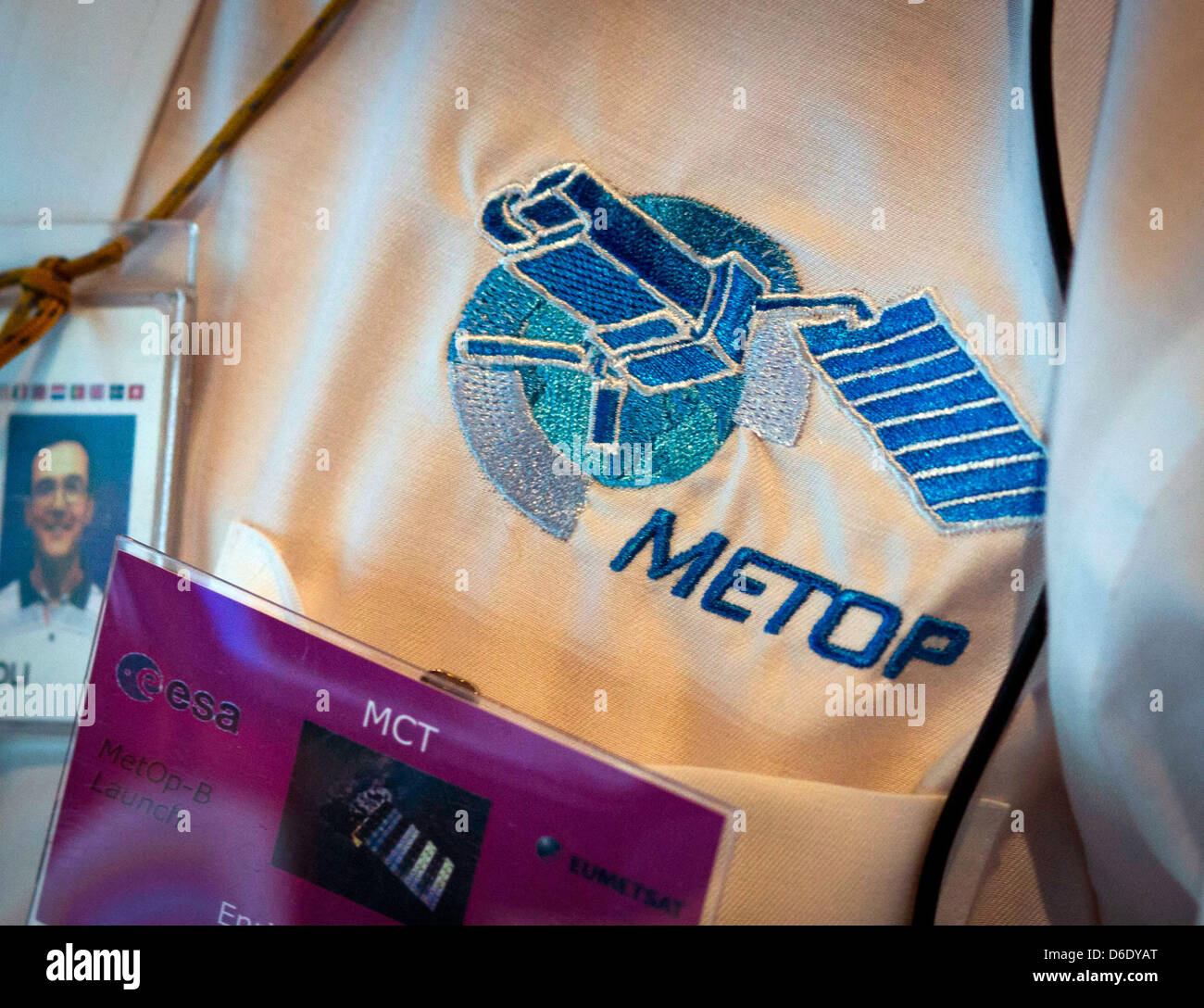 The logo of European weather satellite Metop-B is on display at a garment of an ESA employee at a European Space Stock Photo