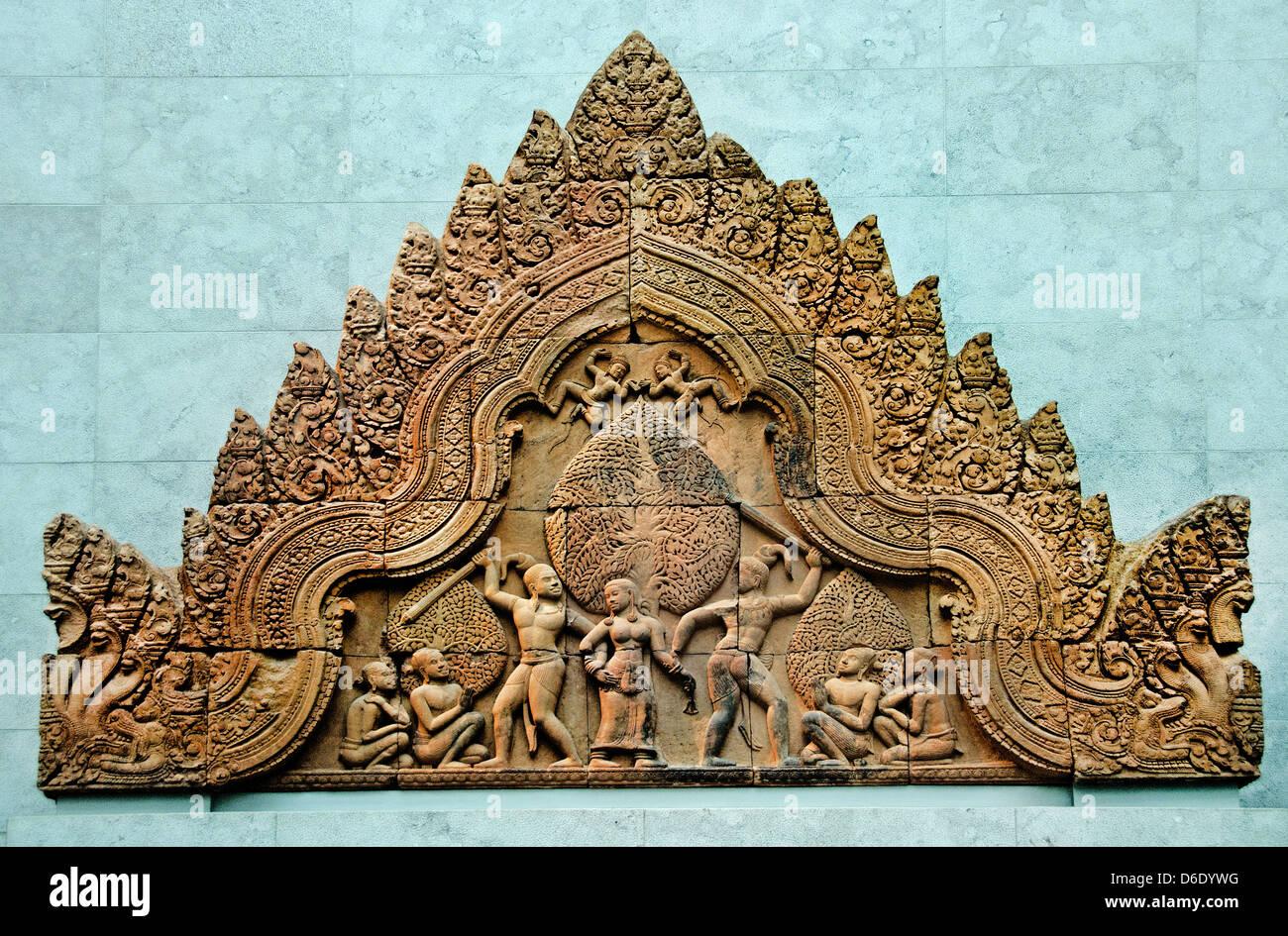 Fronton the Sunda and asura Upasunda disputing the apsara Tilattama. Cambodia Siem Reap province Banteay Srei 967 - Stock Image