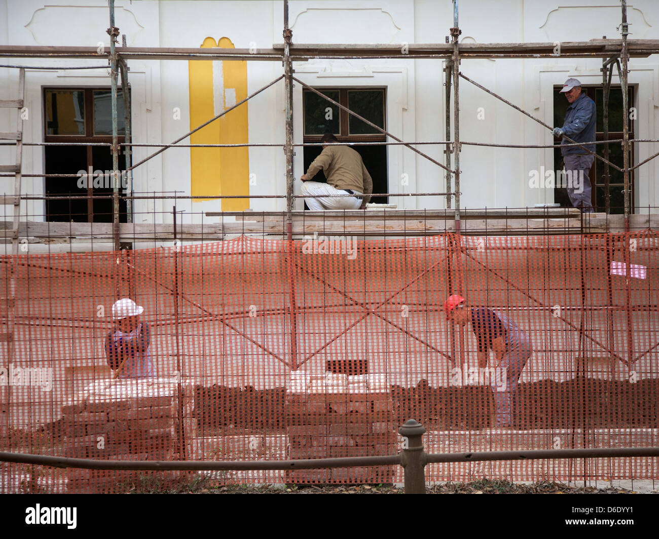 People working on a house reconstruction in Vukovar - Stock Image
