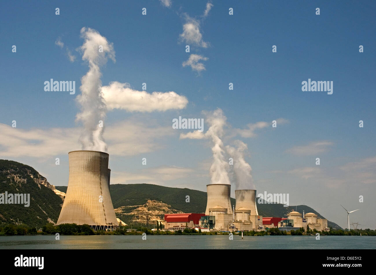 EUROPE, FRANCE, River Rhone, nuclear power station Cruas Meysse, with cooling towers and smoke, and wind turbines - Stock Image