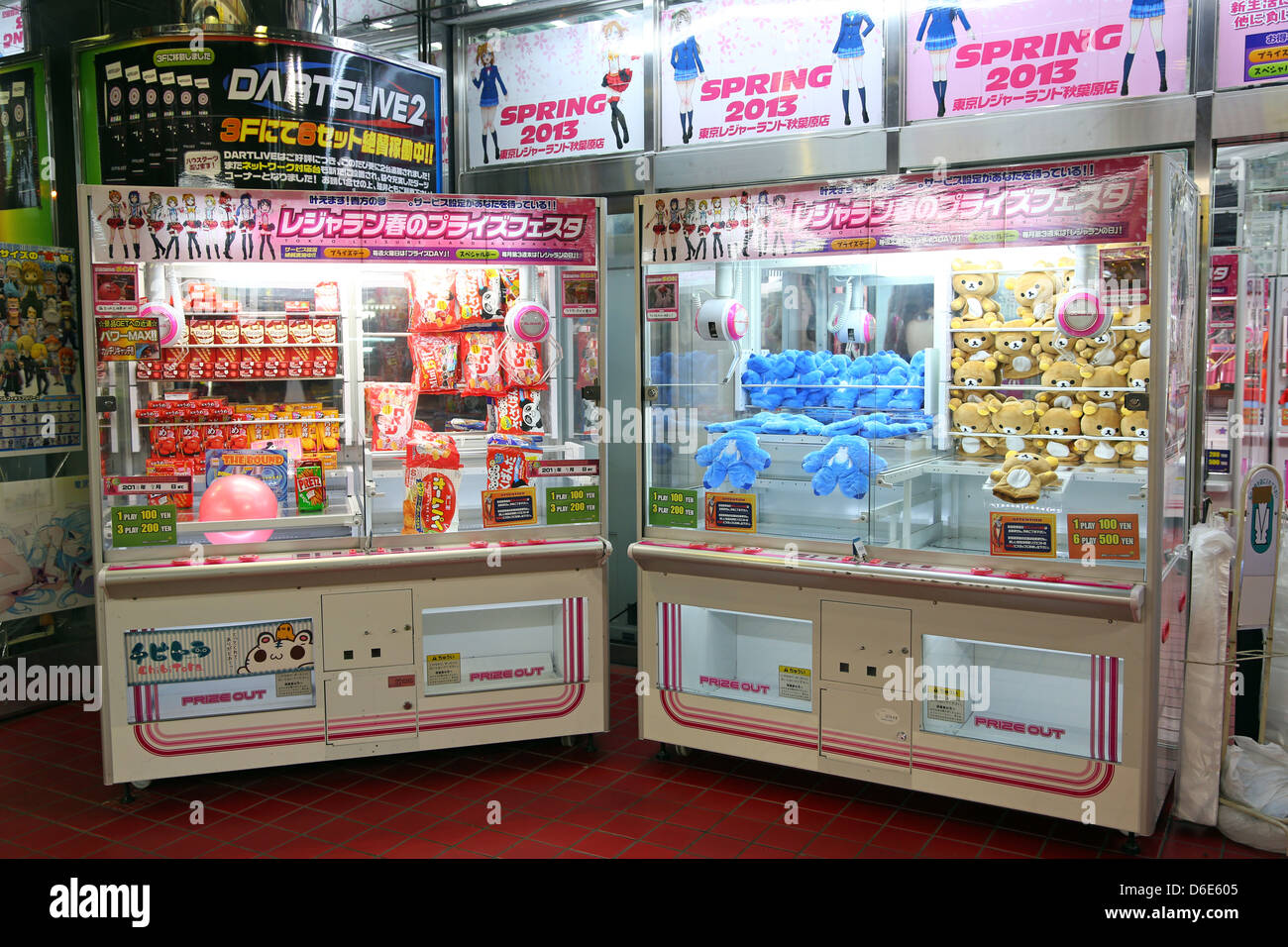 Rilakkuma bear soft toy crane machine in Akihabara Electric Town in Tokyo, Japan - Stock Image