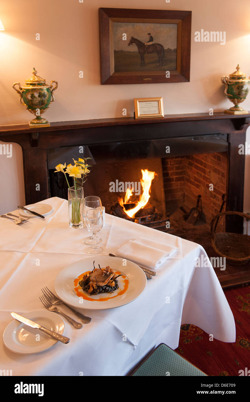 Fireside dining at the Langrish House, Hampshire - Stock Image