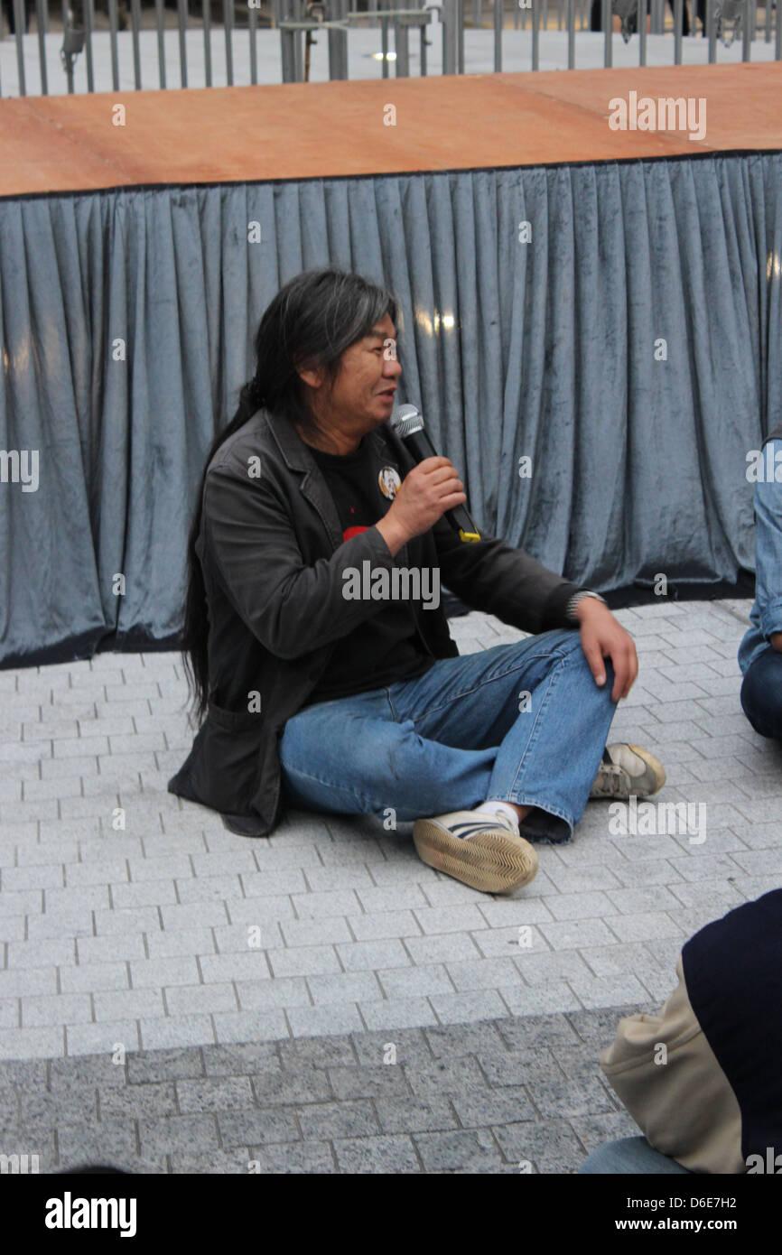 Hong Kong pro-democracy legislator Leung Kwok-hung addresses striking dock workers outside the Hong Kong SAR government - Stock Image
