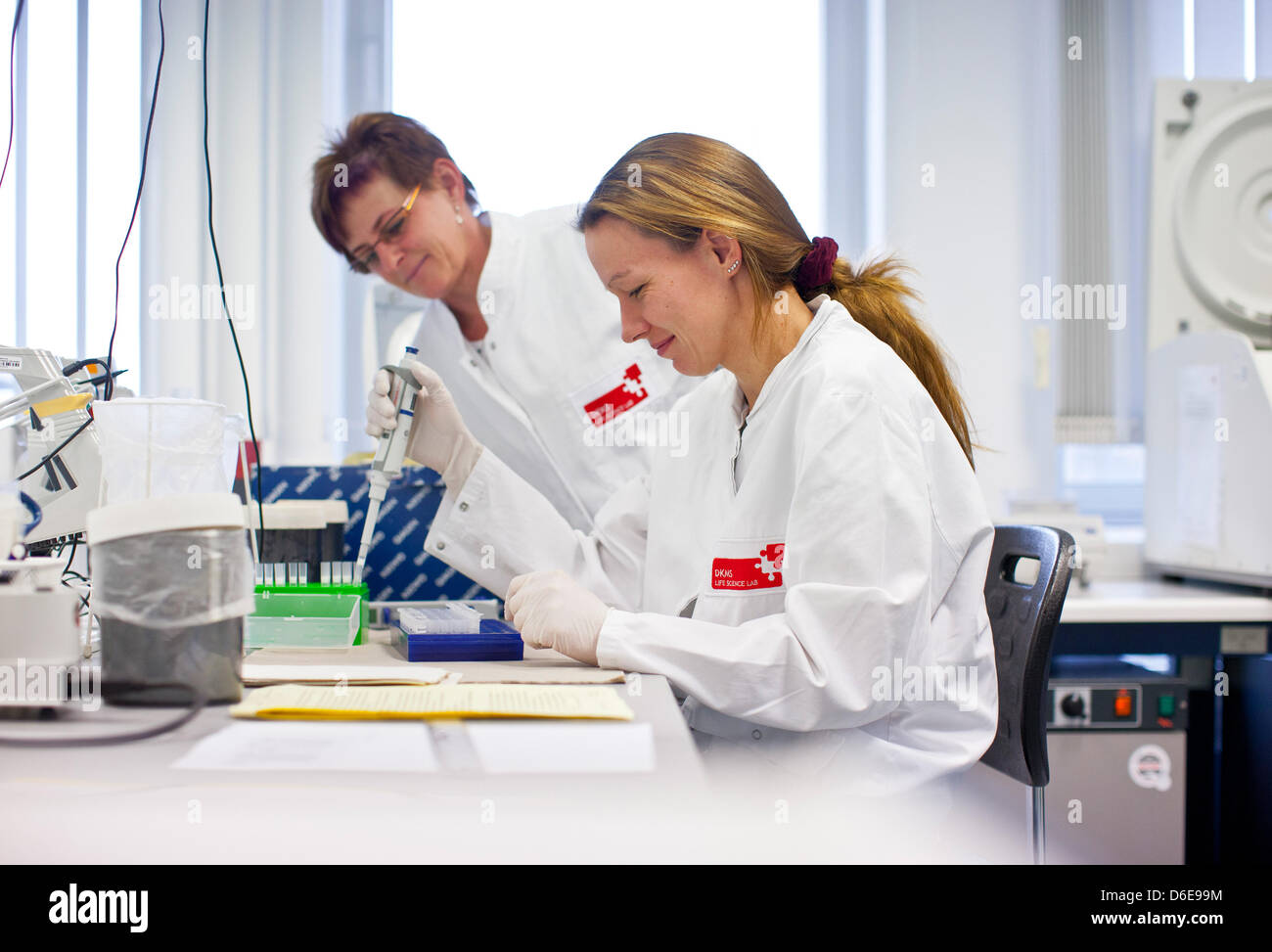 Staff members of the tissue typing laboratory DKMS Life Science Lab extract DNA from a tissue sample in Dresden, - Stock Image
