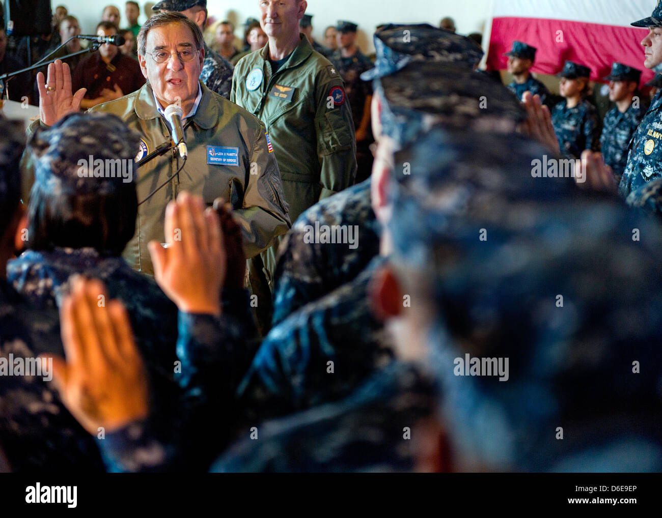 United States Secretary of Defense Leon E. Panetta re-enlists 21 Sailors Saturday, January 21, 2012 aboard the aircraft Stock Photo