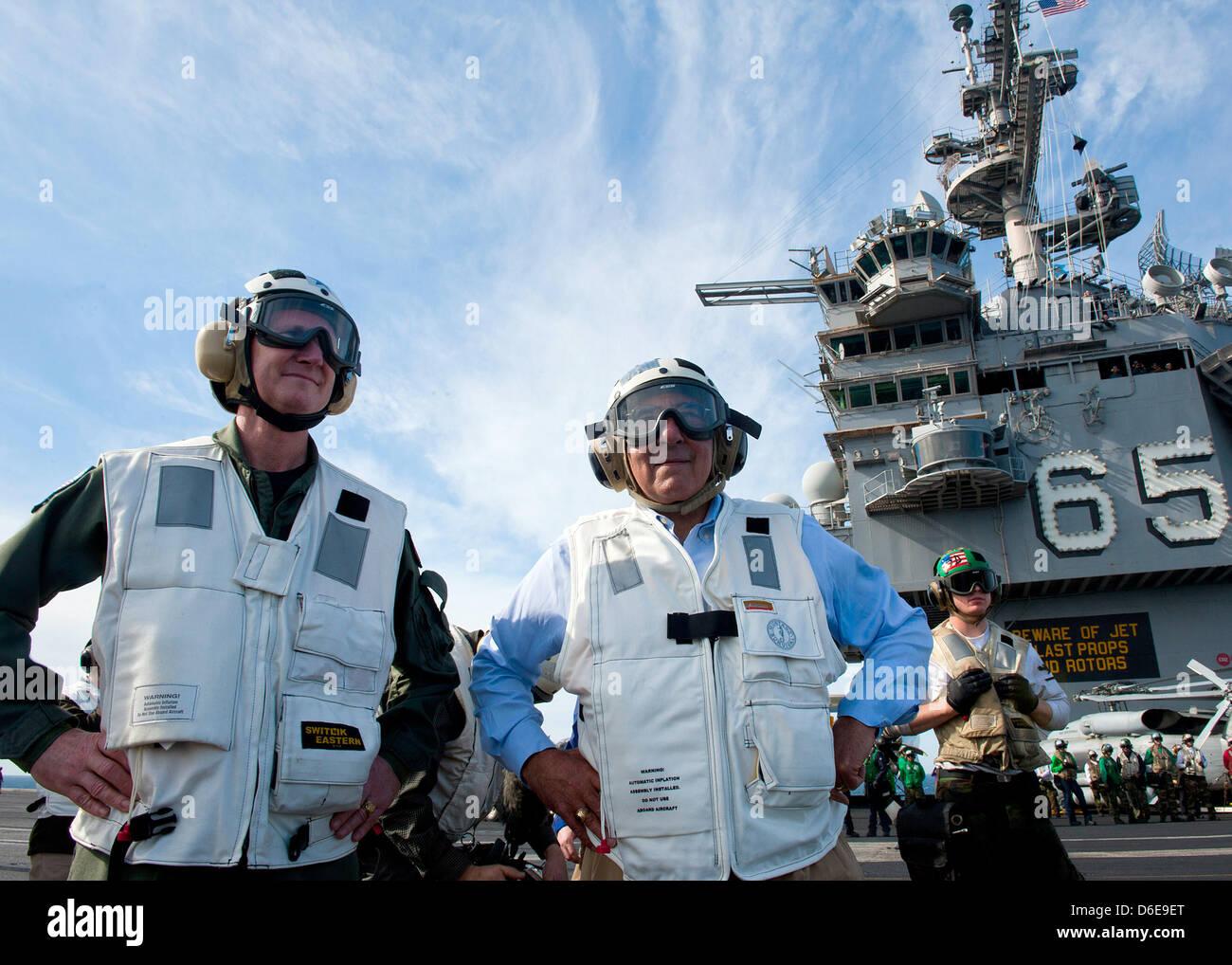 United States Secretary of Defense Leon E. Panetta, right, and Rear Admiral Walter E. Carter, commander of Carrier Stock Photo