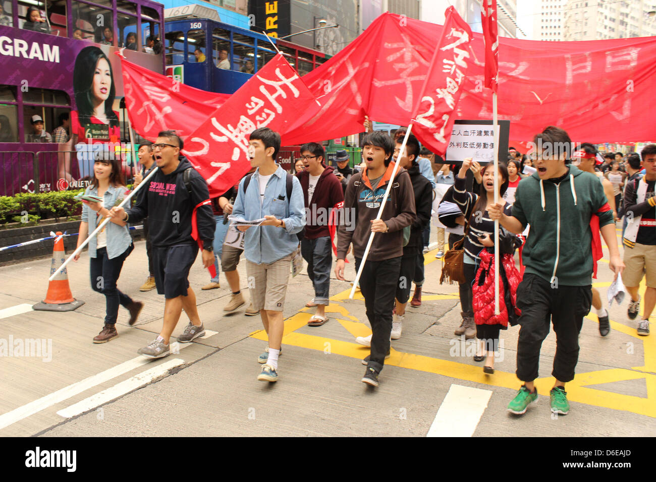 An image of Susan Li (from financial TV station Bloomberg) looks down in disbelief on a march by striking Hong Kong - Stock Image
