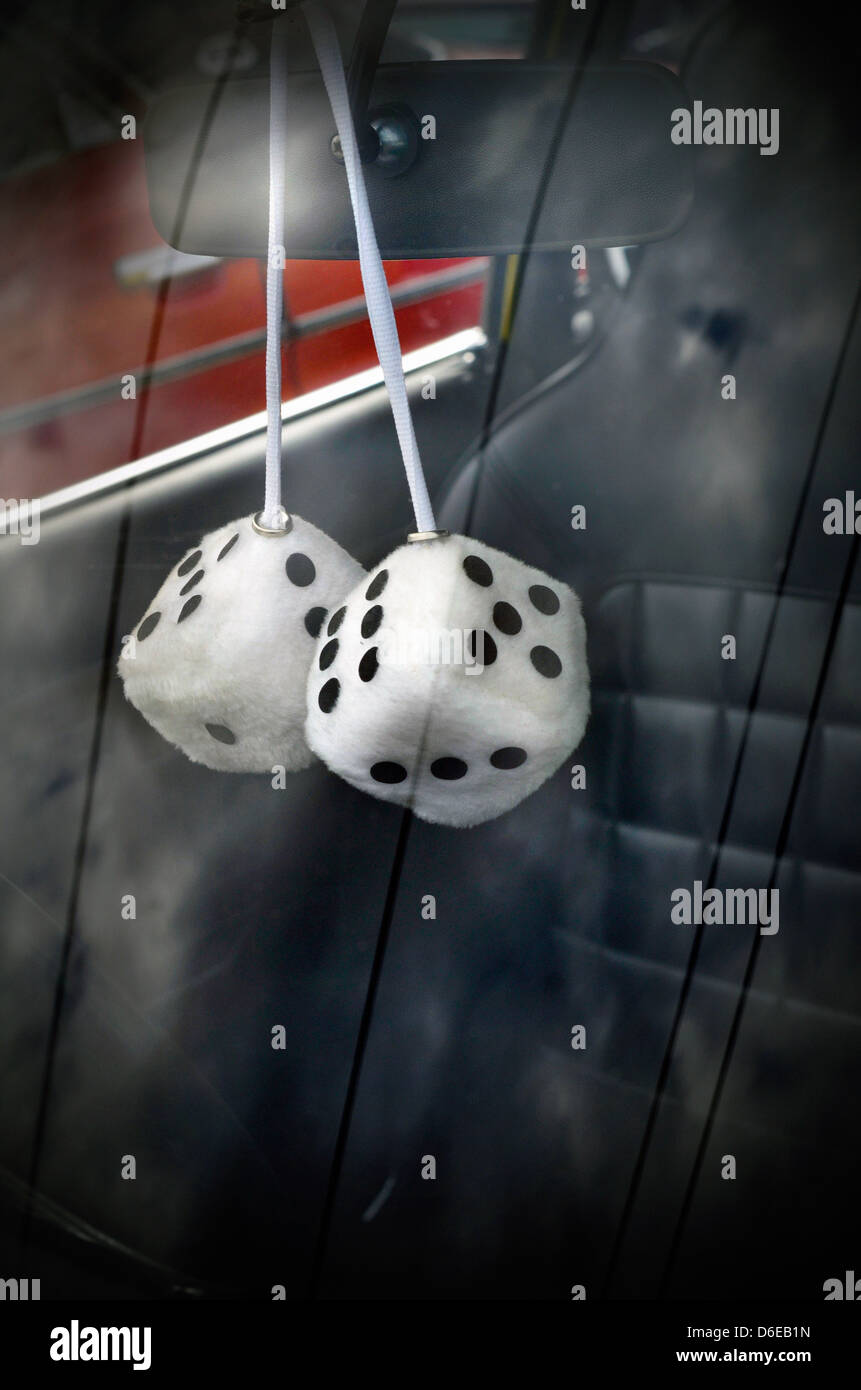 furry dice in car - Stock Image