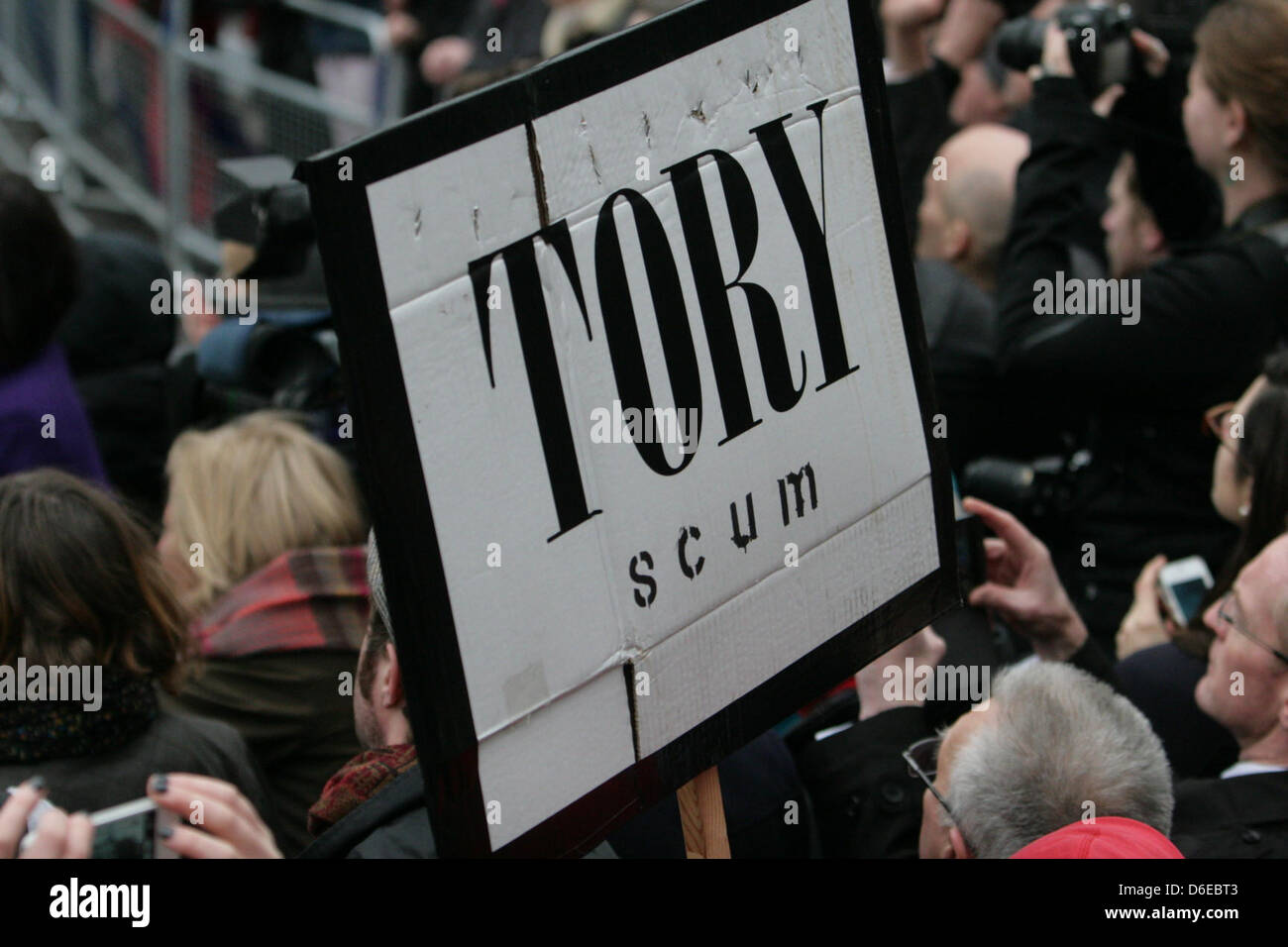 17 April 2013  London, UK. Protesters with placard as Baroness Thatcher's funeral cortège makes it's - Stock Image