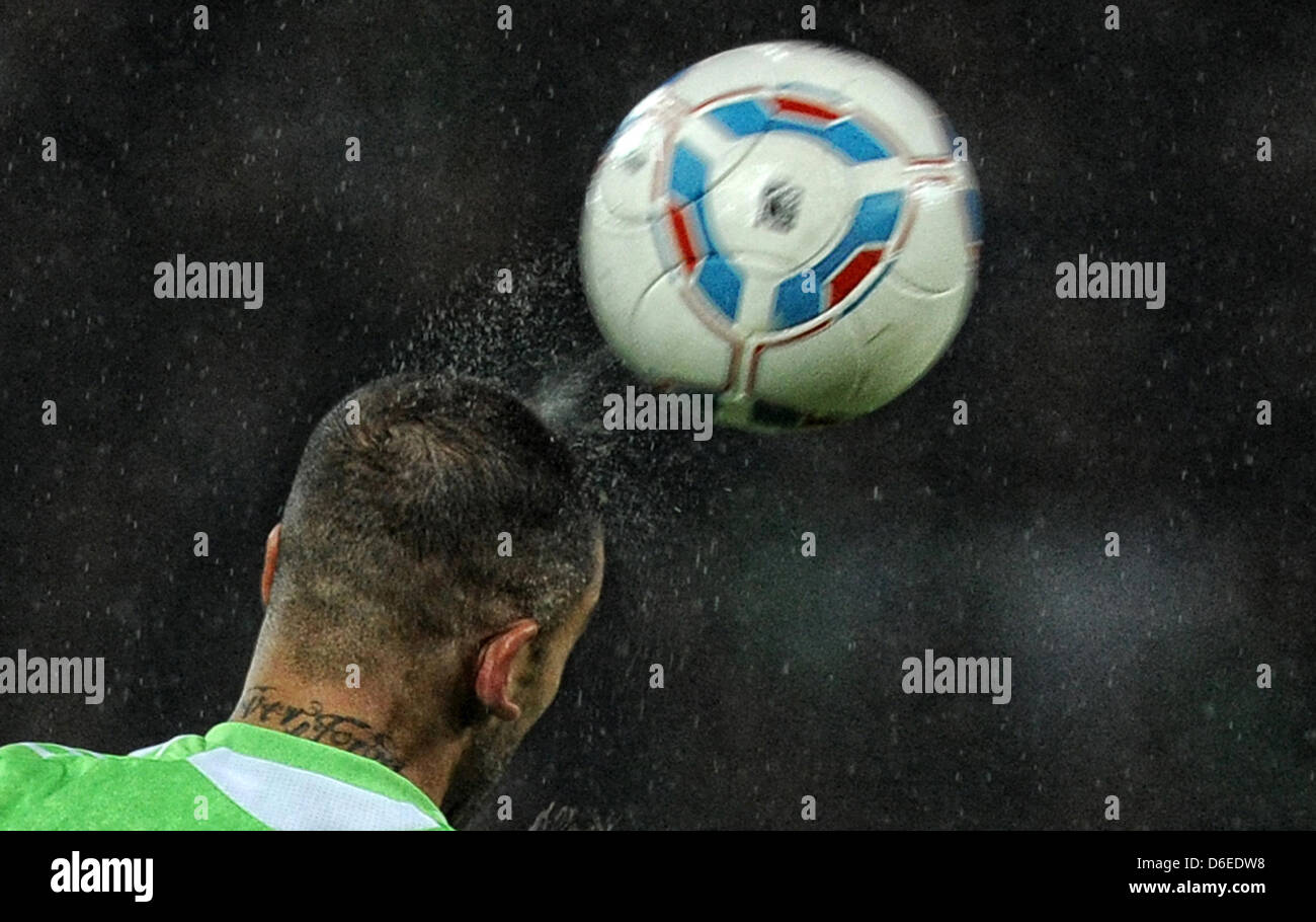 (FILE) - A file picture dated 21 January 2012 shows Wolfsburg's player Ashkan Dejagah performing a header during - Stock Image