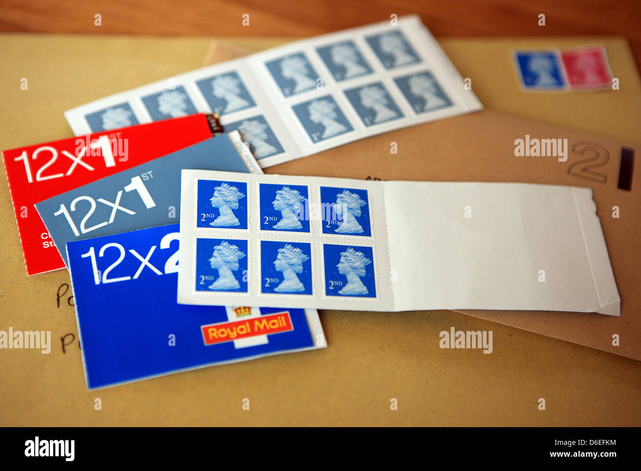 UK stamps sitting on top of envelopes - Stock Image
