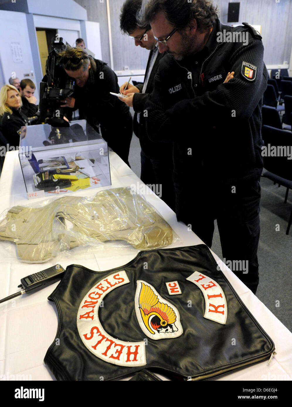 A Hells Angels vest confiscated by police, a police radio