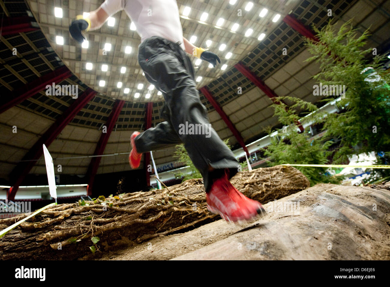 A runner jumps across an obstacle at the Westfalenhalle in Dortmund, Germany, 03 February 2012. People who like - Stock Image