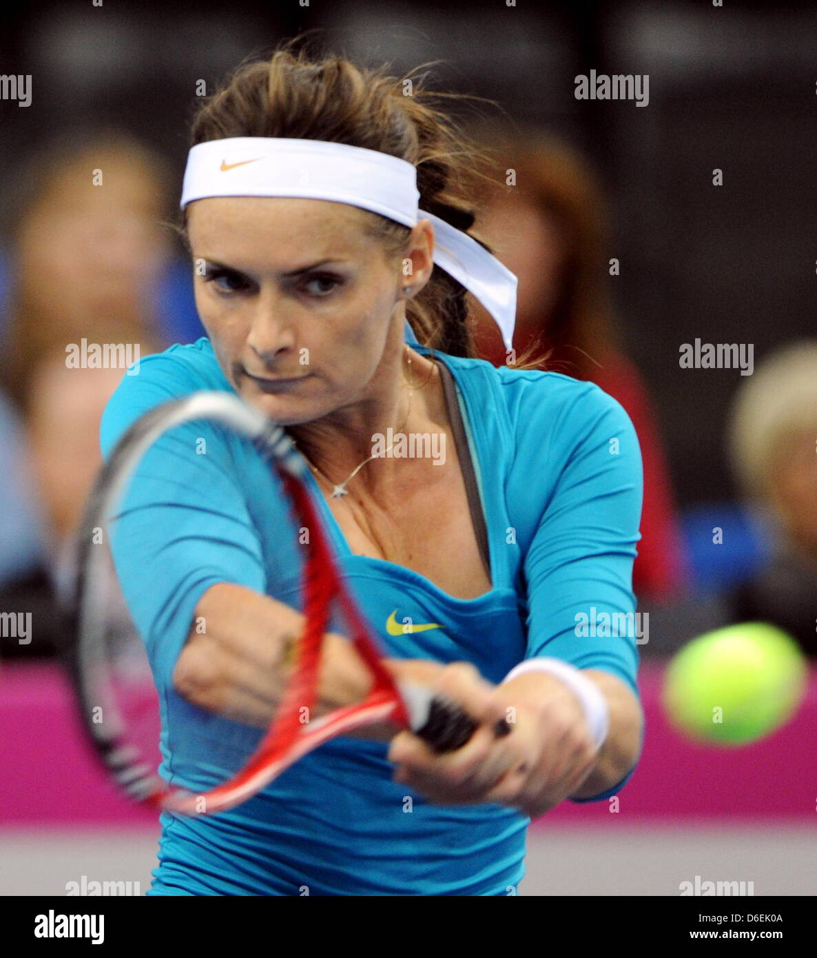 Czech tennis professional Iveta Benesova competes against Germany's Sabine Lisicki during the Fed Cup quarter - Stock Image