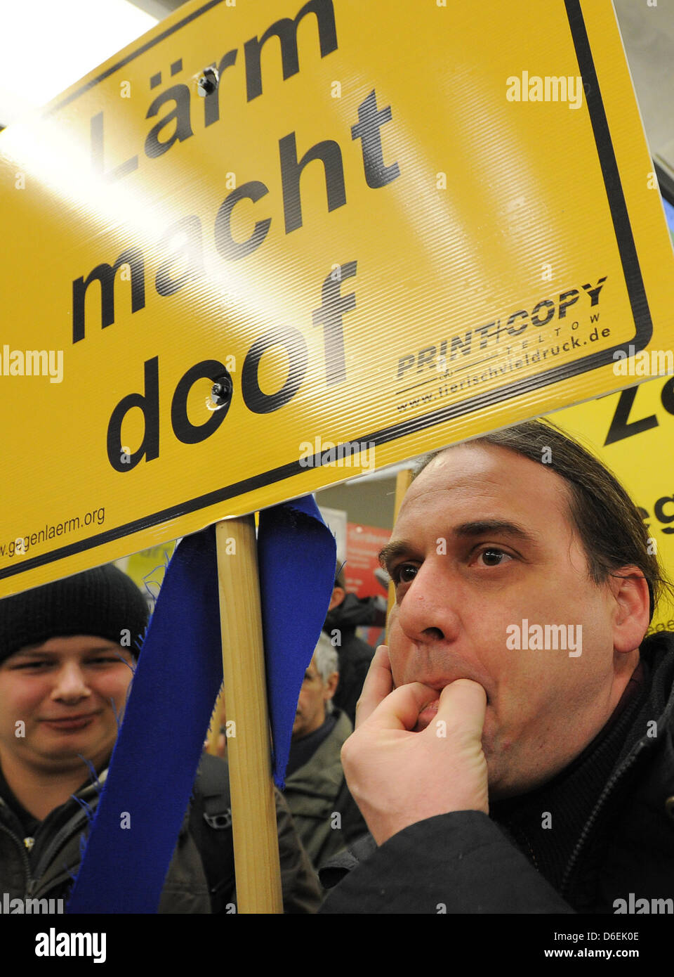 Opponents of the new  Berlin Brandenburg Airport (BER) demonstrate against aircraft noise at the airport's terminal - Stock Image