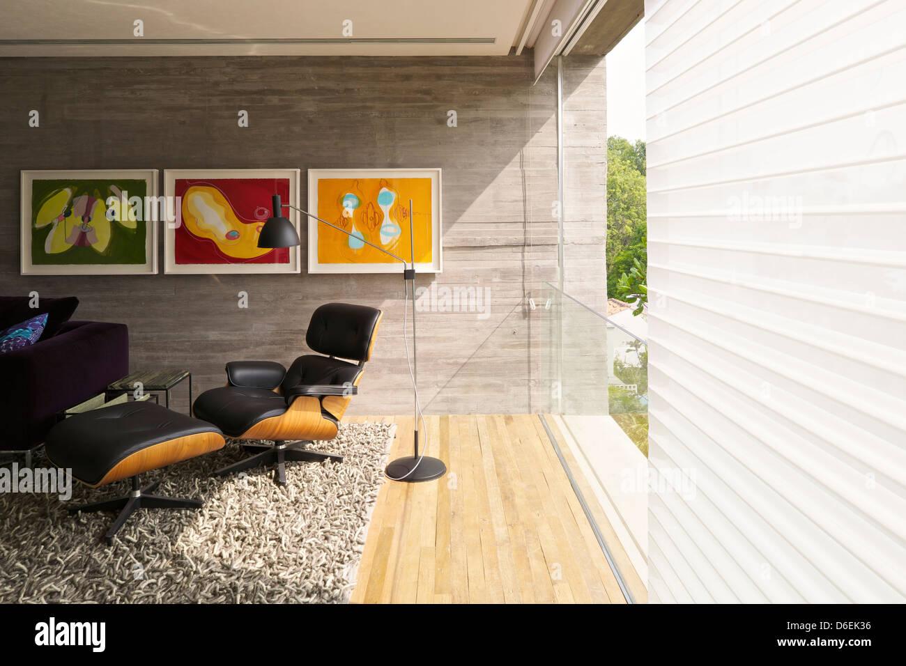 Casa Cubo, Sao Paulo, Brazil. Architect: Studio MK27- Marcio Kogan, 2012. First floor view with Eames Lounge Chair. Stock Photo